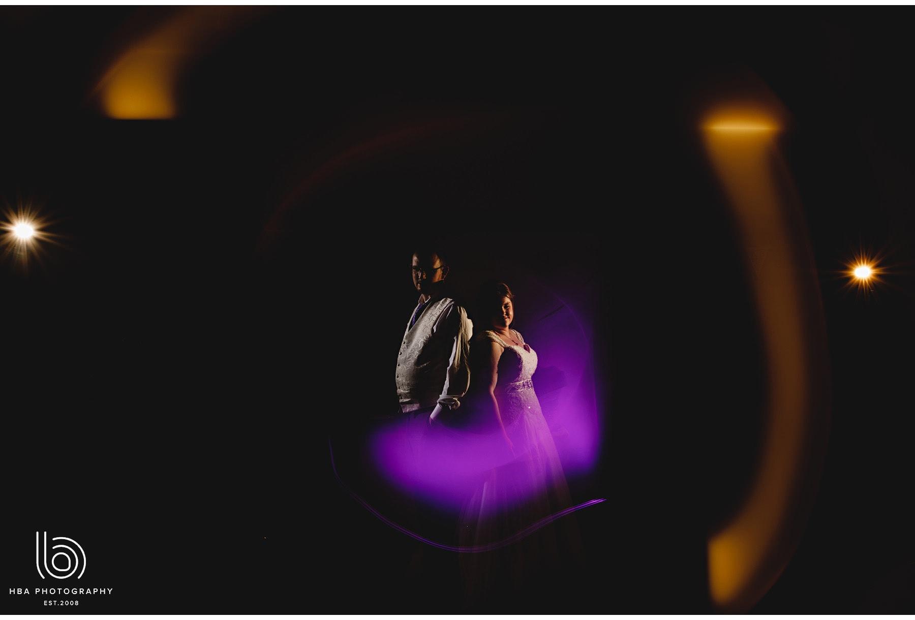 the bride & groom in the pruple