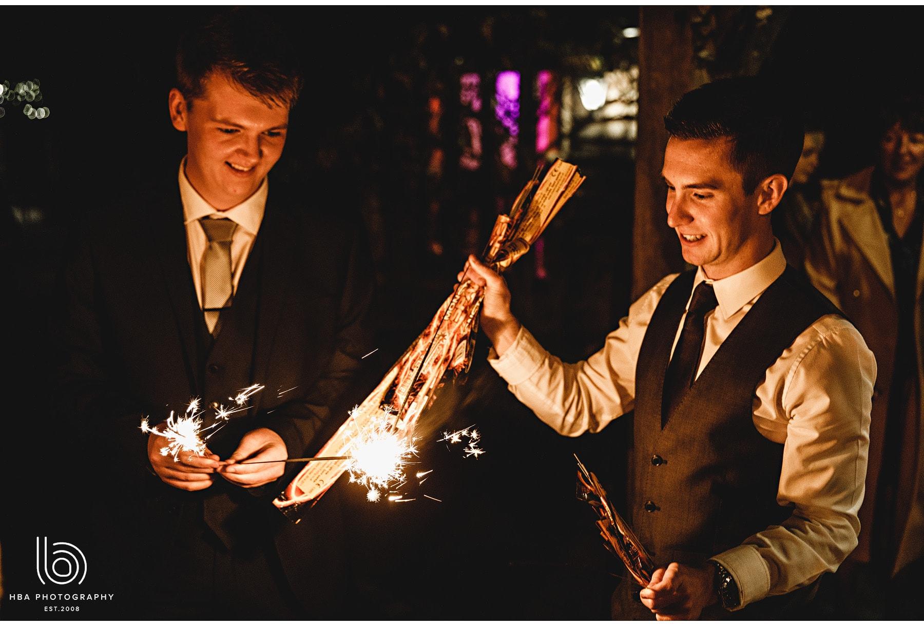 groomsmen lighting sparklers