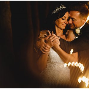 the bride & groom in the fairy lights