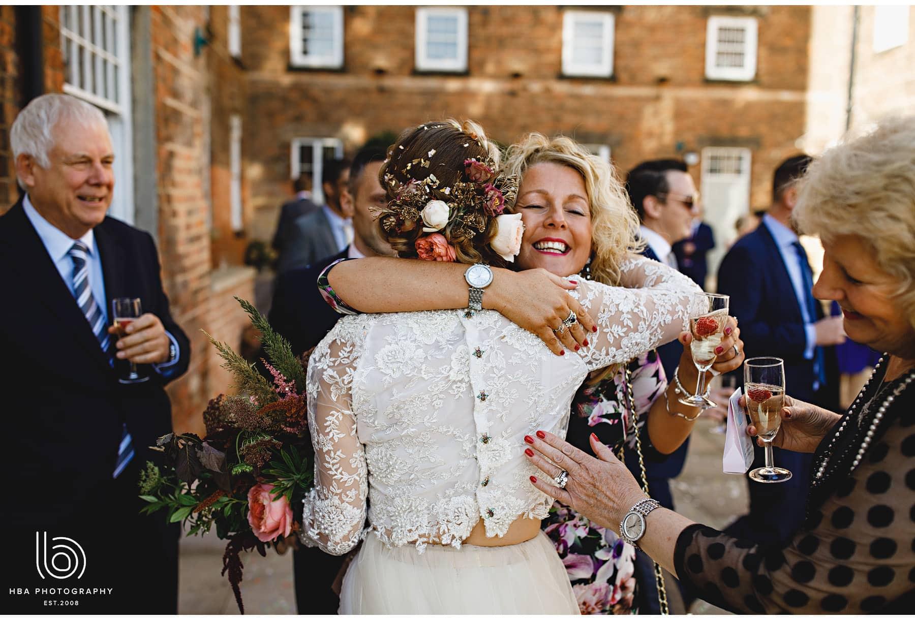 the bride hugging guests