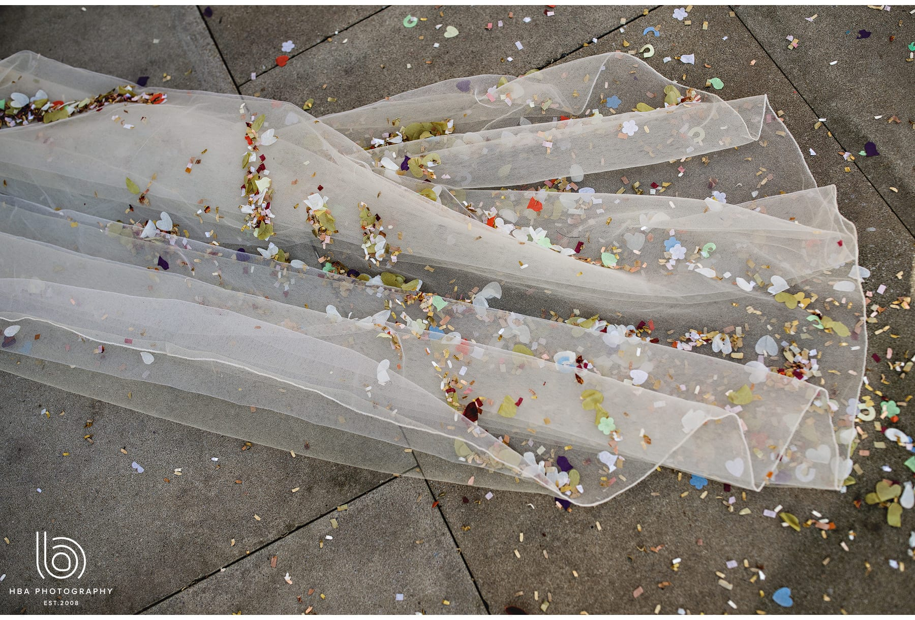 the bride's dress covered in confetti