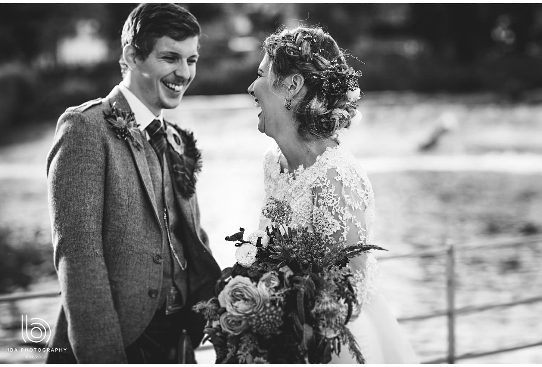 the bride & groom laughing