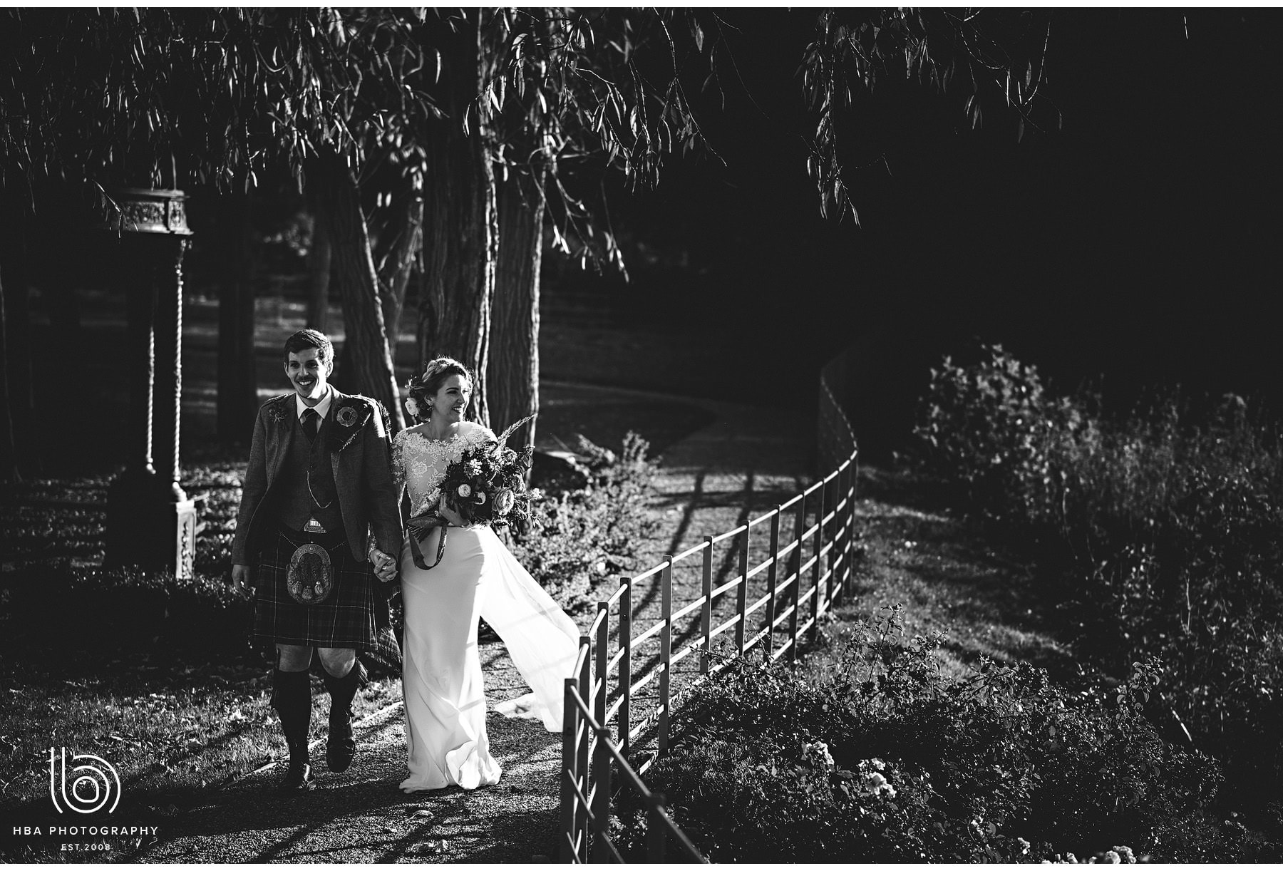 the bride & groom walking by the river