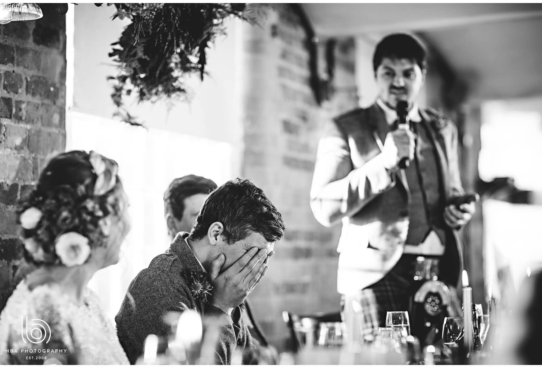 the best man embarrasing the groom