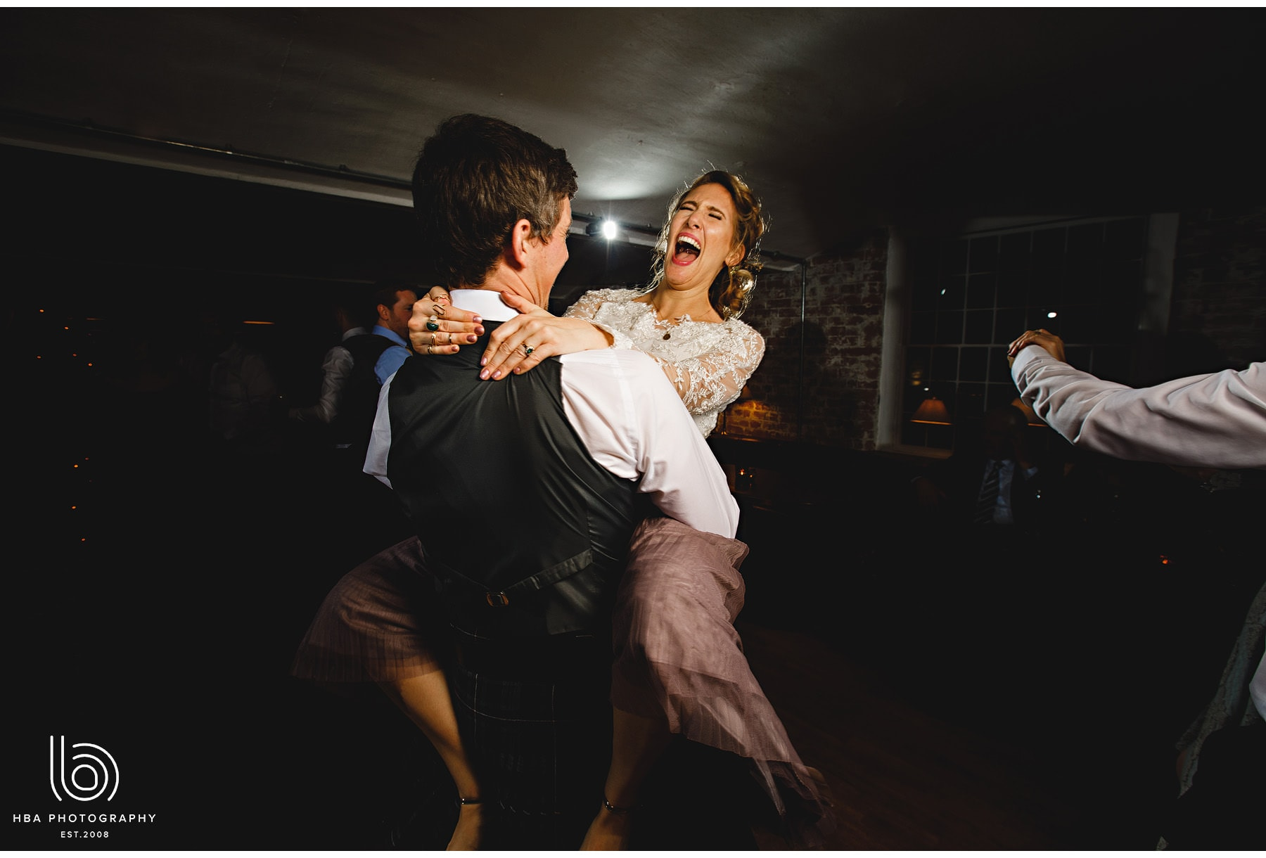 the bride dancing with her new husband