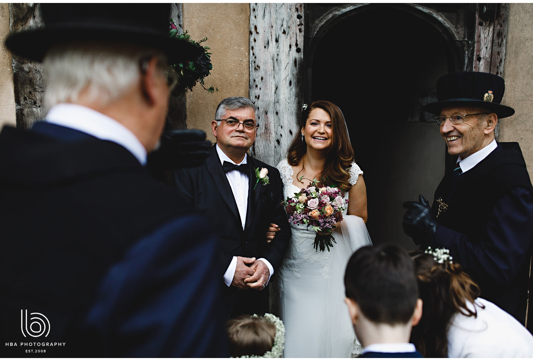 the bride and her dad about to walk into the ceremony