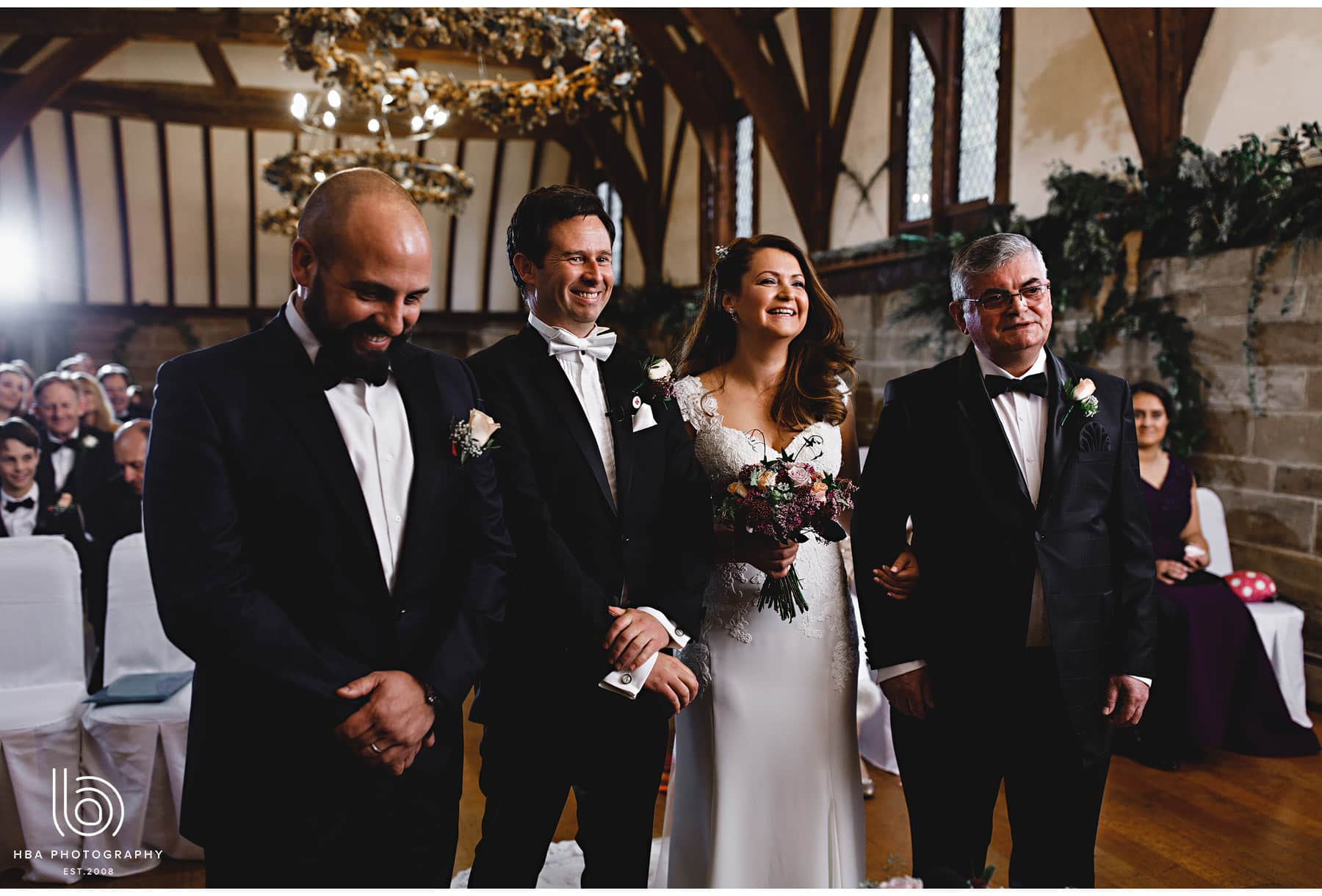 the bride, groom, father and best man
