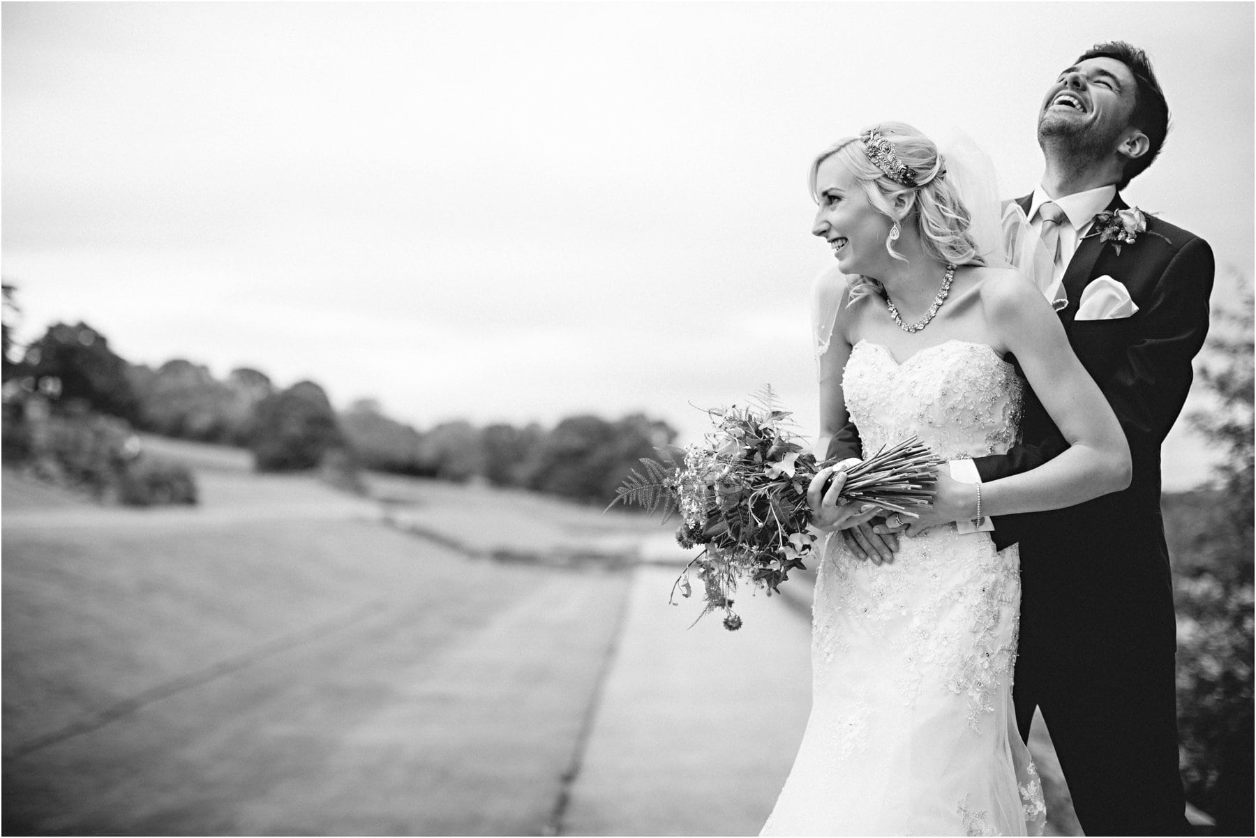 the bride & groom in the ground of Osmaston park