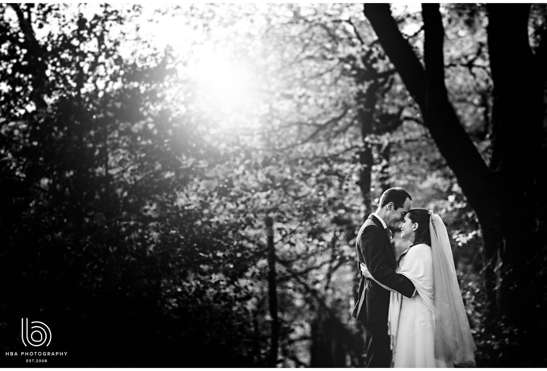 the bride & groom in the autumn leaves