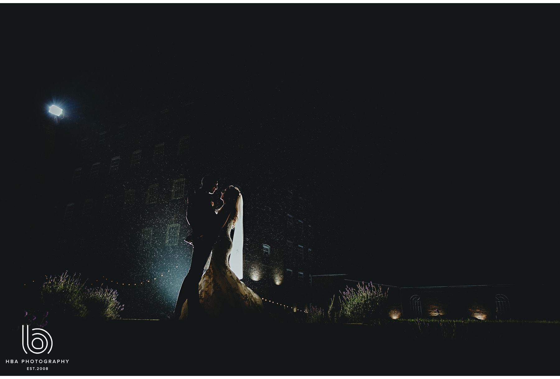 the bride & groom in the dark
