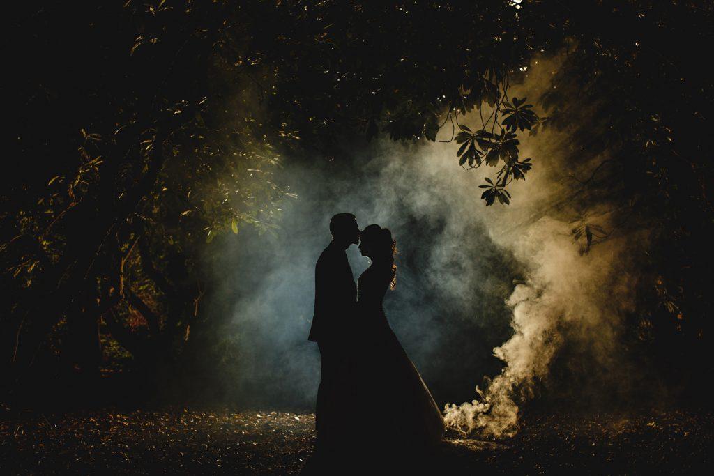 brde and groom stood in smoke