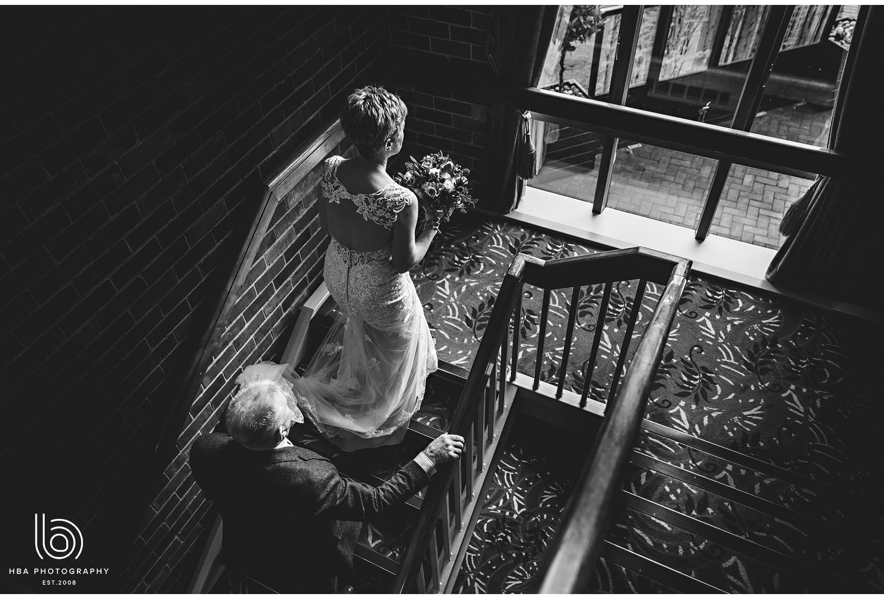 the bride walking up the stairs