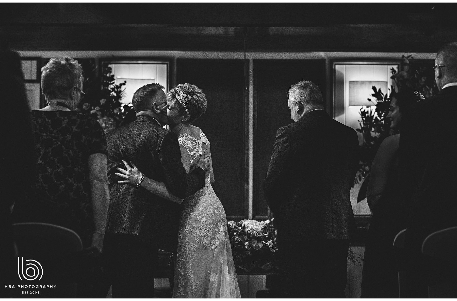 the bride kissing the groom