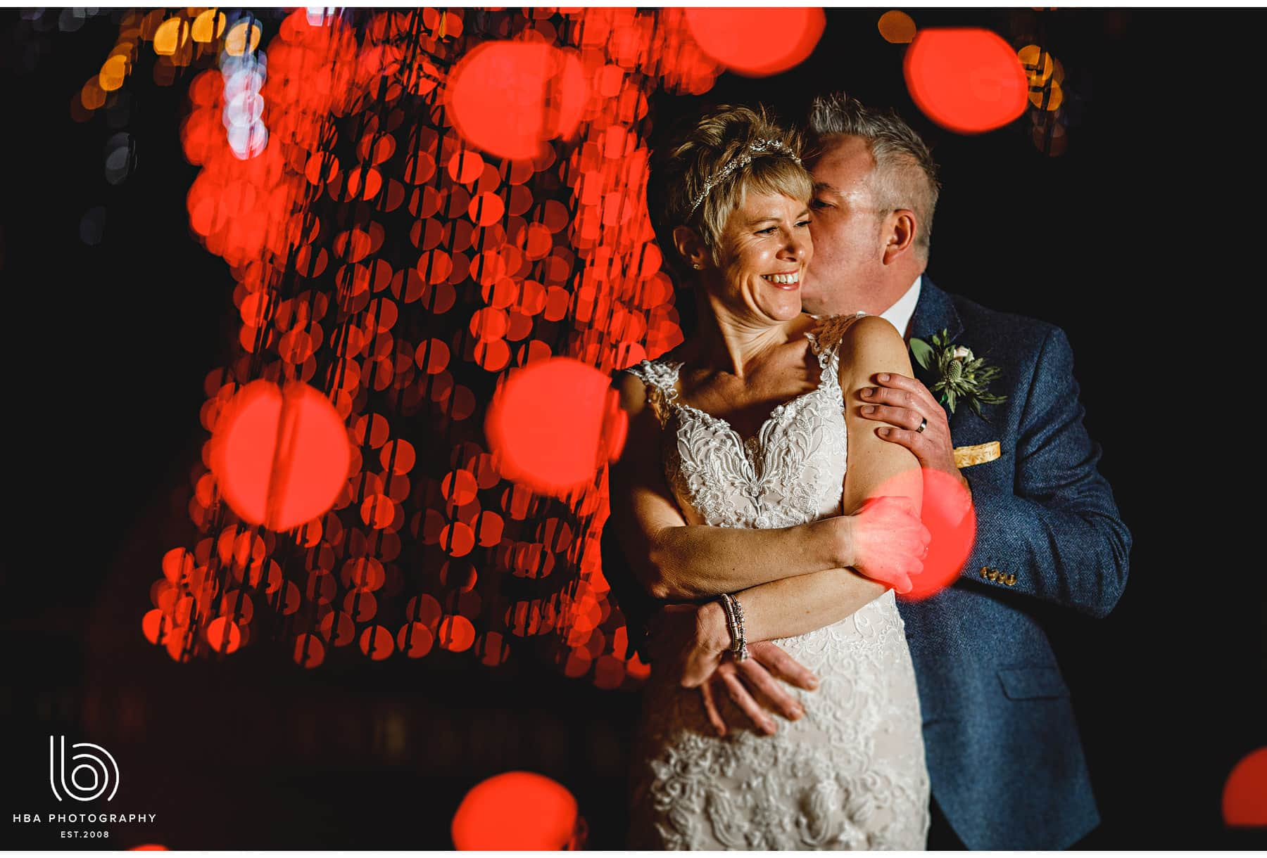 the bride & groom in the fairly lights