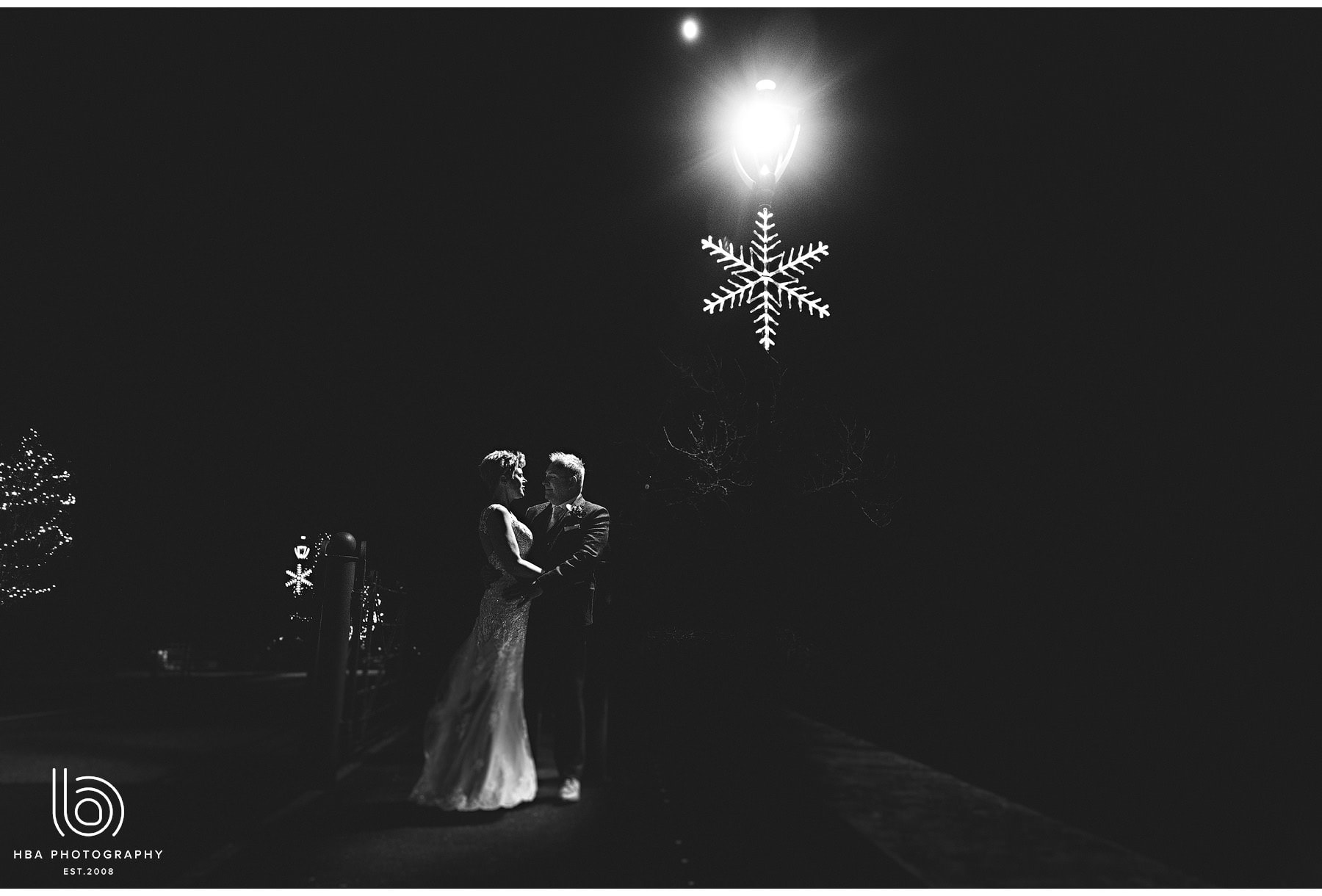 the bride & groom with the christmas decorations