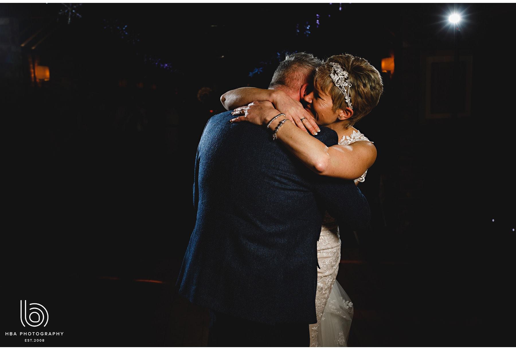 the bride & groom hugging