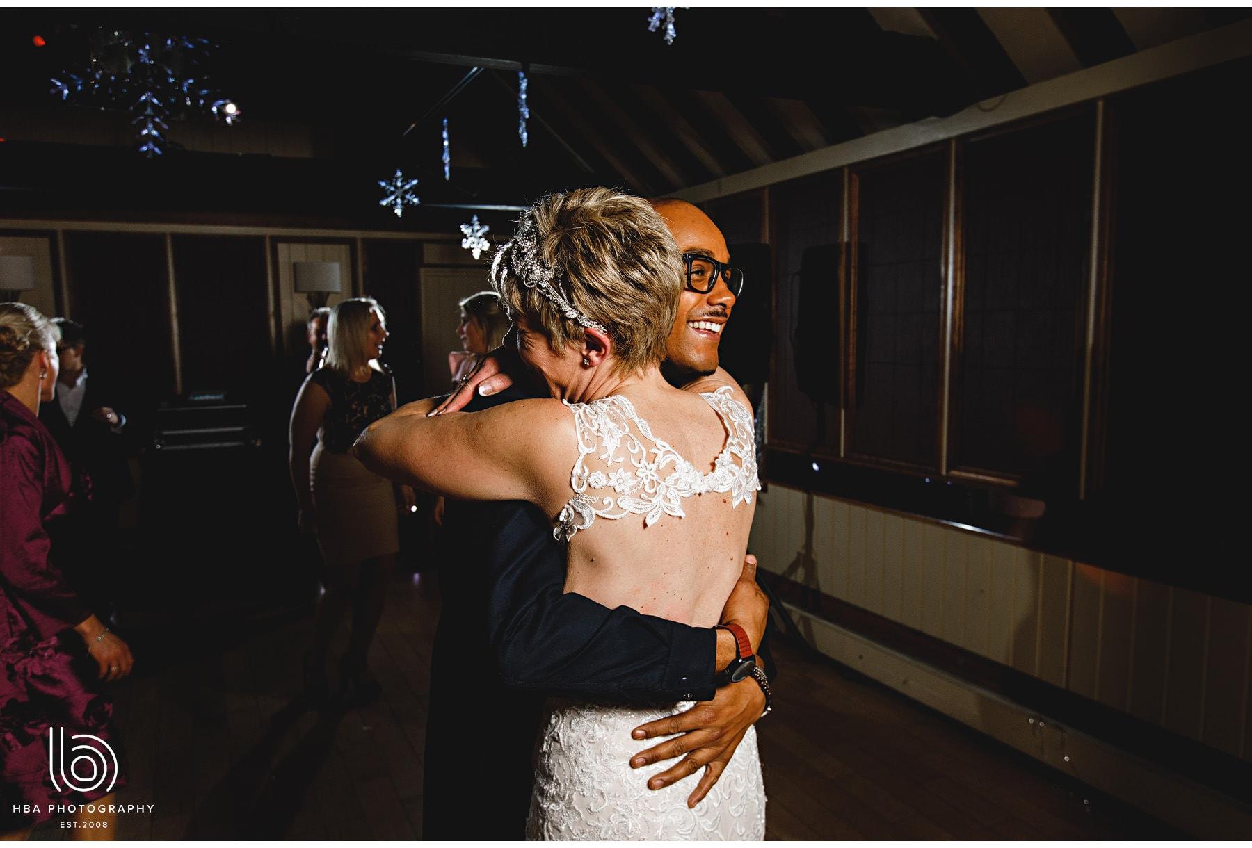 the bride hugging friends