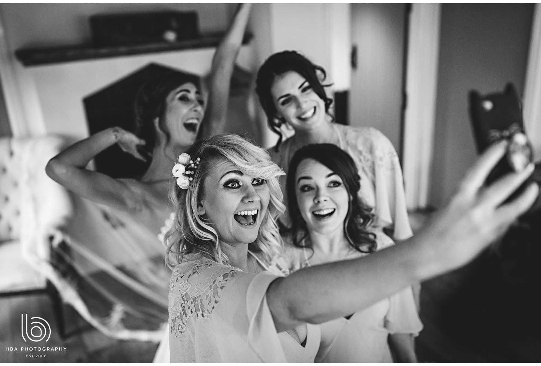 the bridesmaids taking a selfie