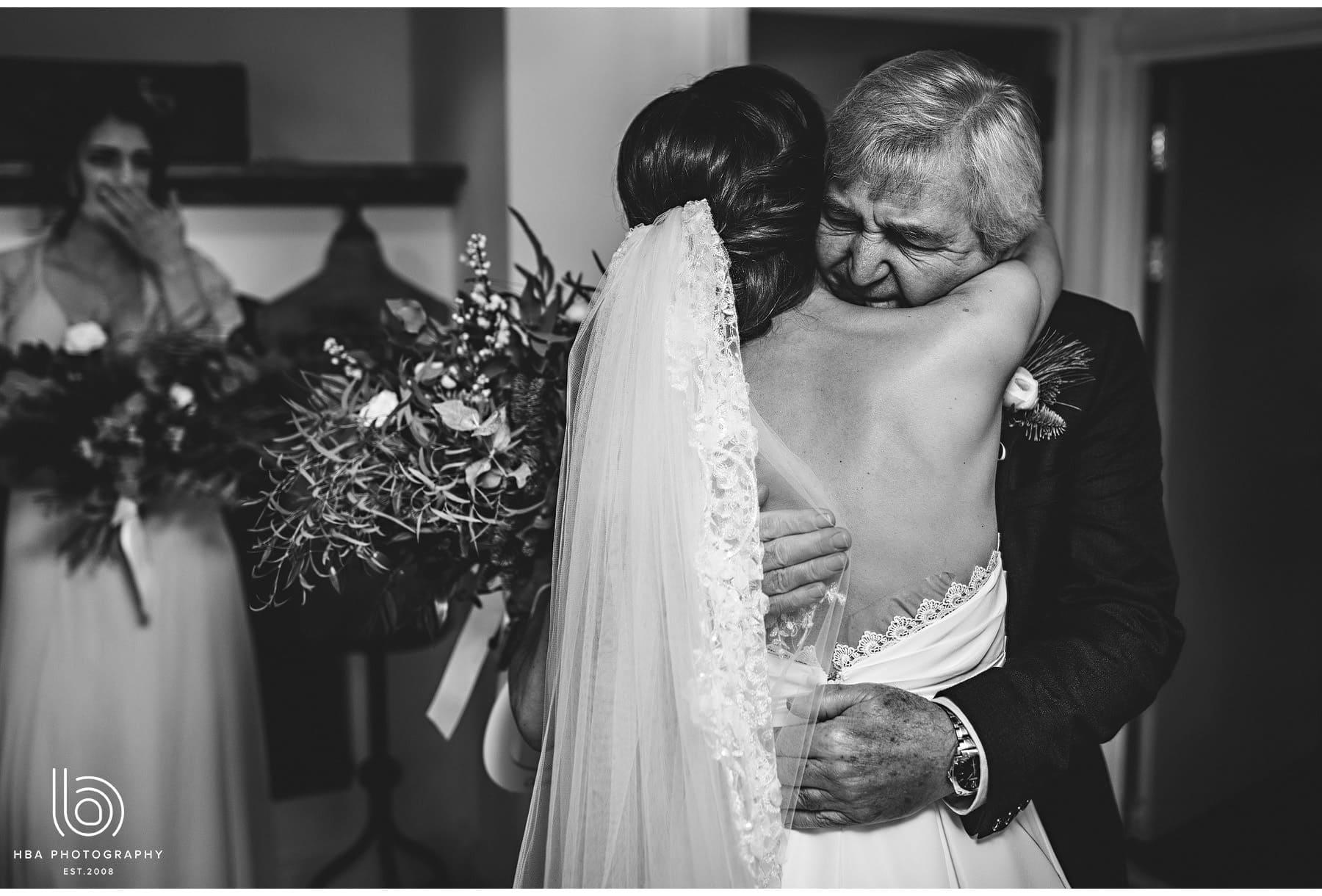the bride hugging her dad