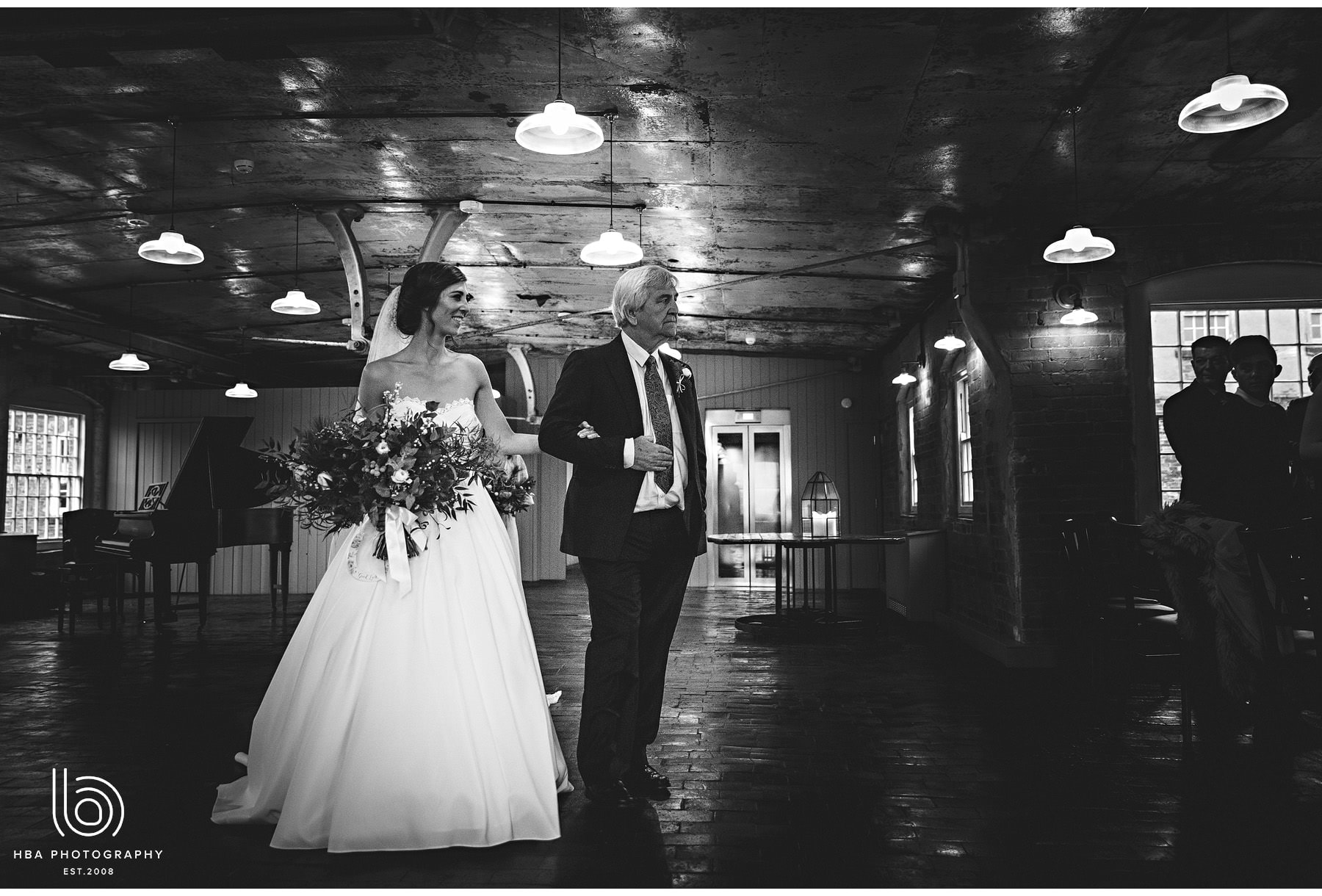 the bride and her dad walking into the ceremony