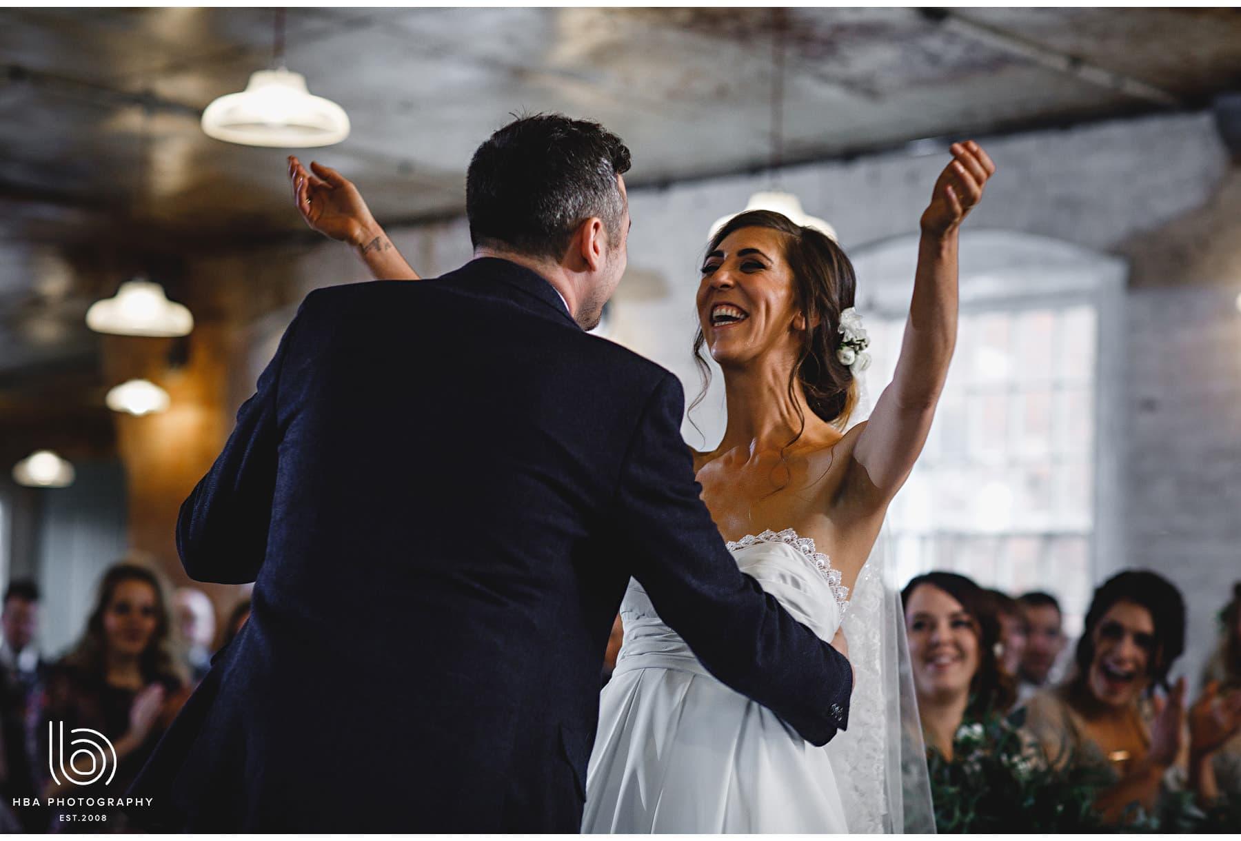 the bride hugging her husband