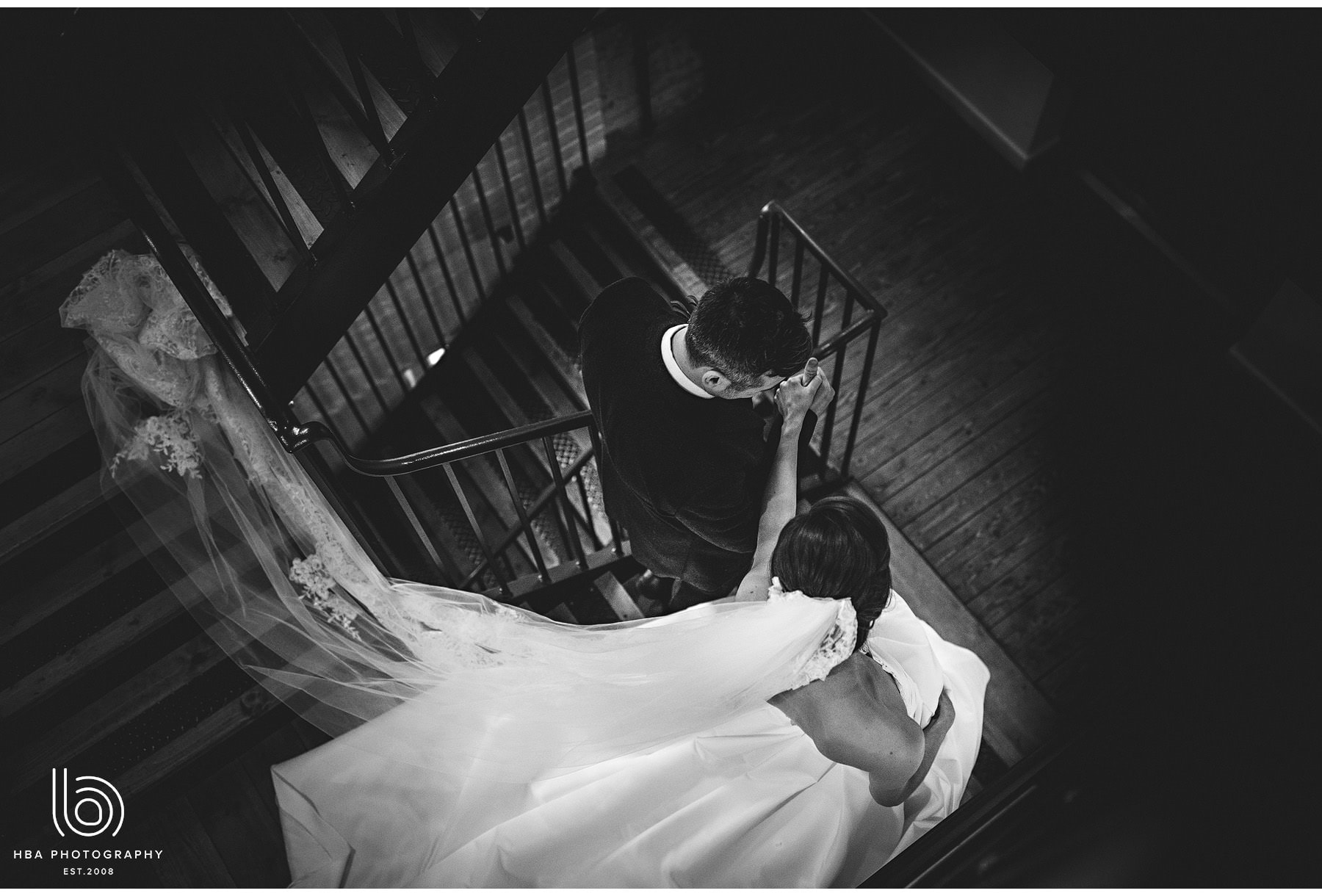 the bride and groom walking down the stairs