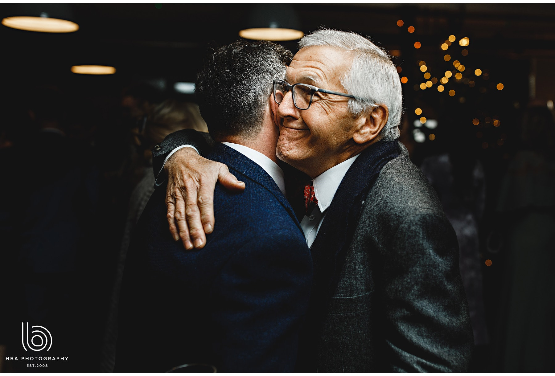 the groom hugging his uncle