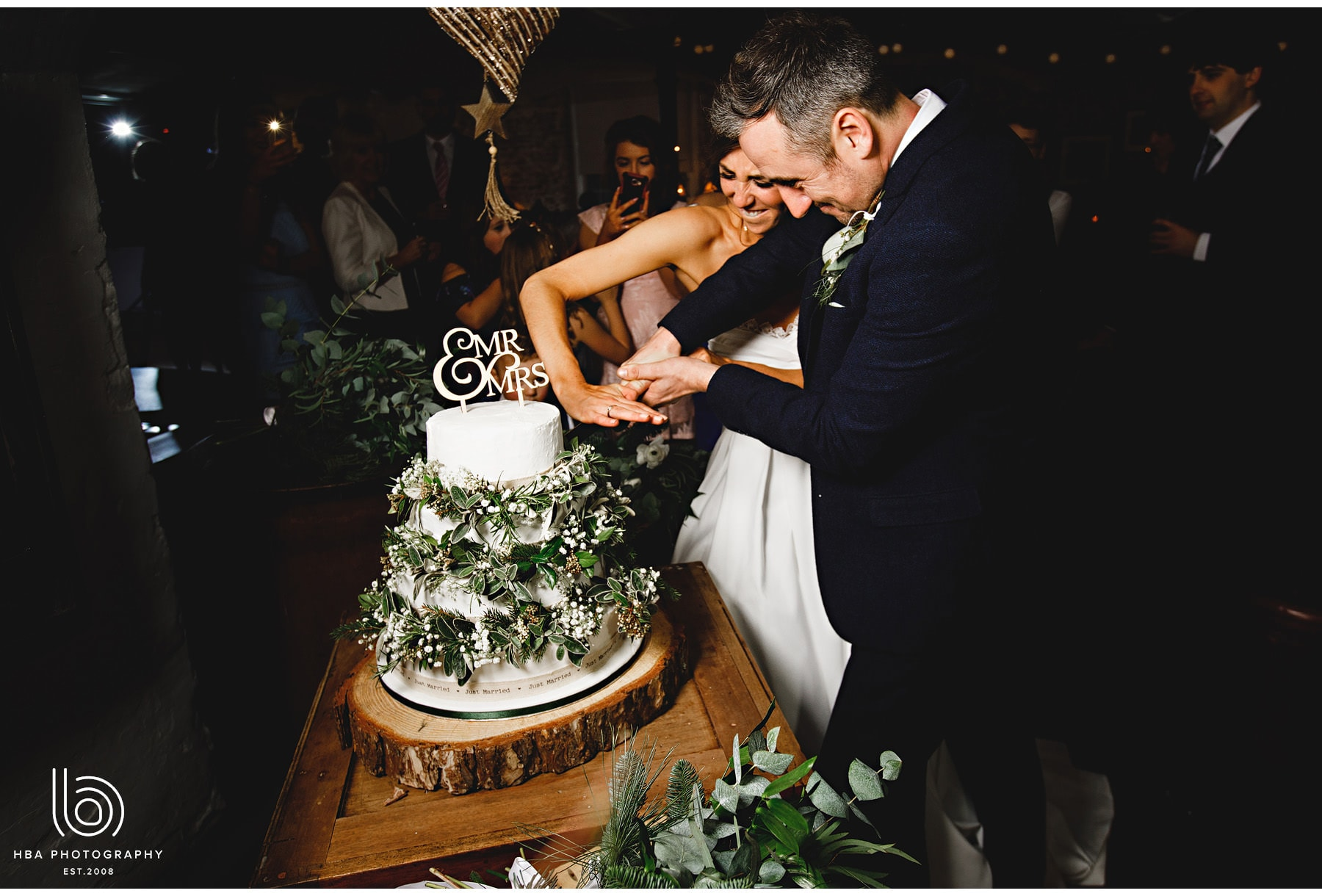 the bride and groom cutting their cake