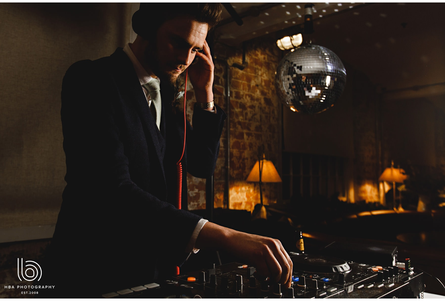 the bride's brother DJing