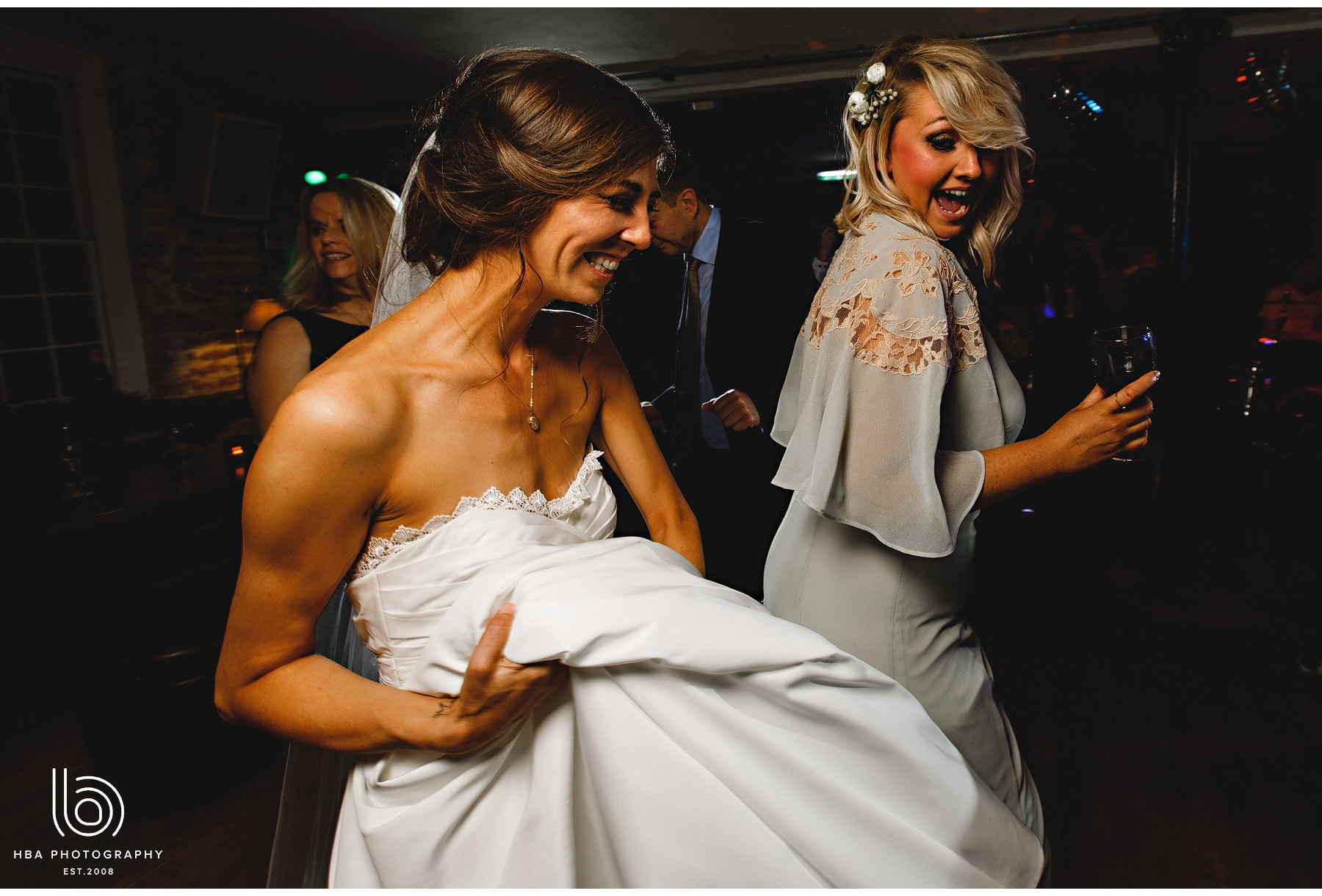the bride dancing with her bridesmaids