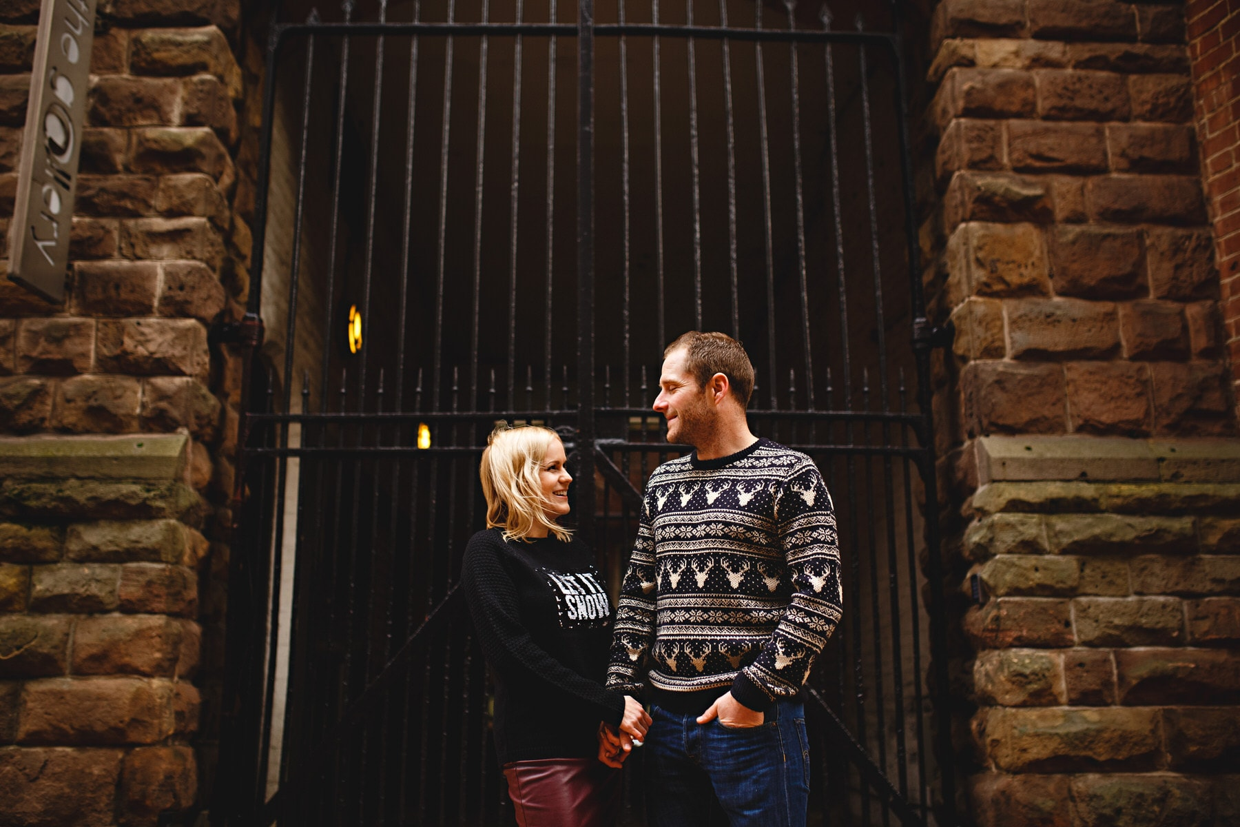matching stipy jumpers on their engagement photoshoot in the city