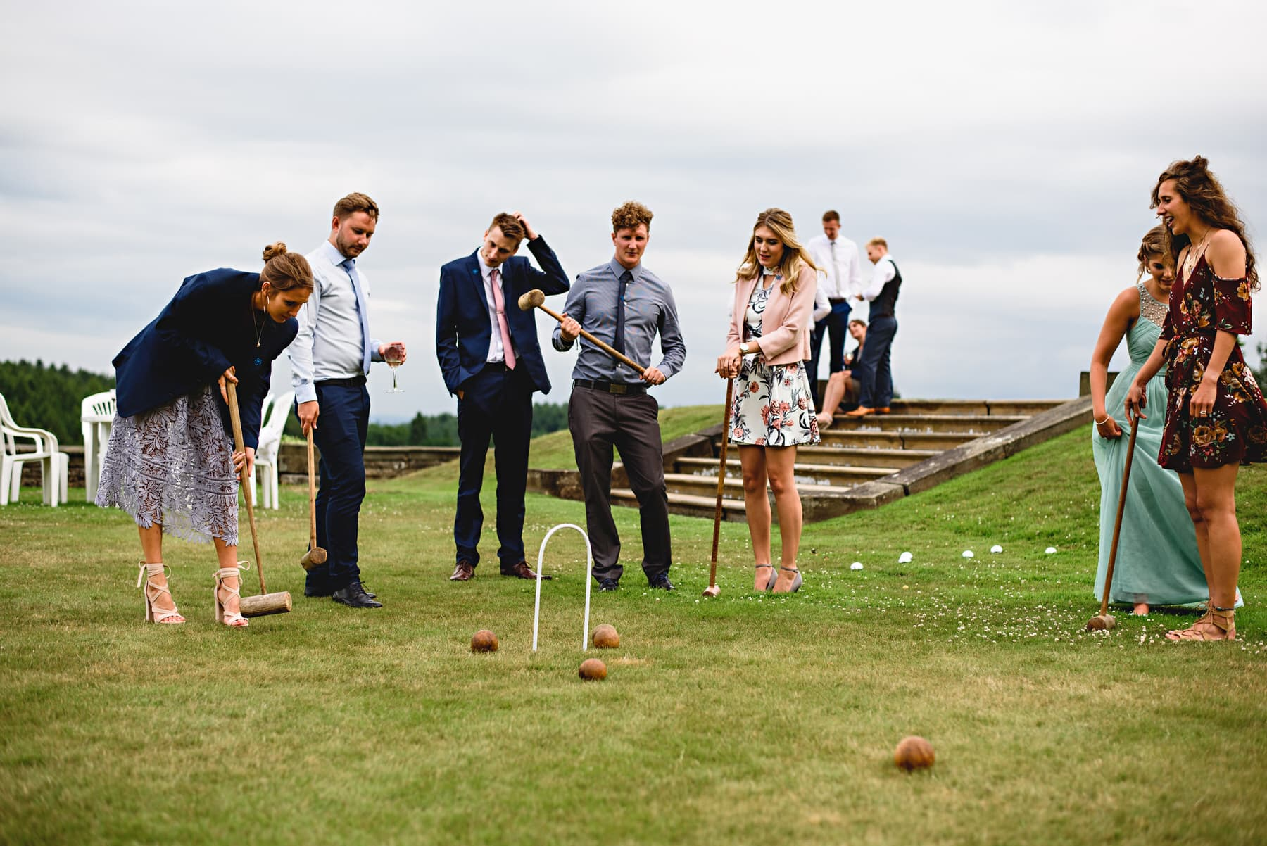 wedding guests on the lawns playing games