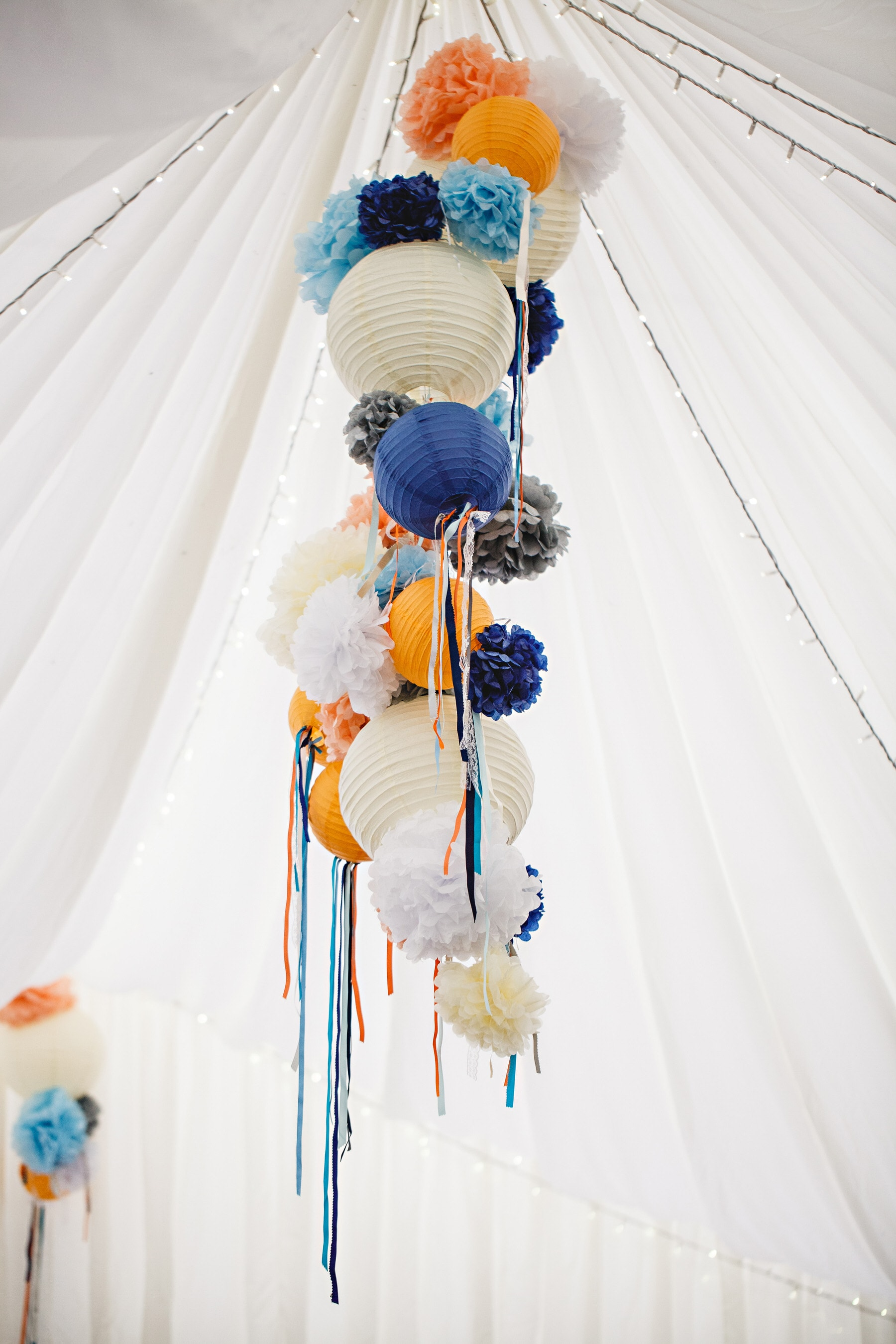colourful hanging lanterns in the marquee at Osmaston Park in Derbyshire