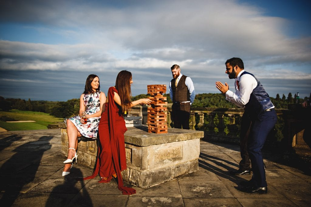 wedding guests playing giant jenga at a derbyshire wedding venue