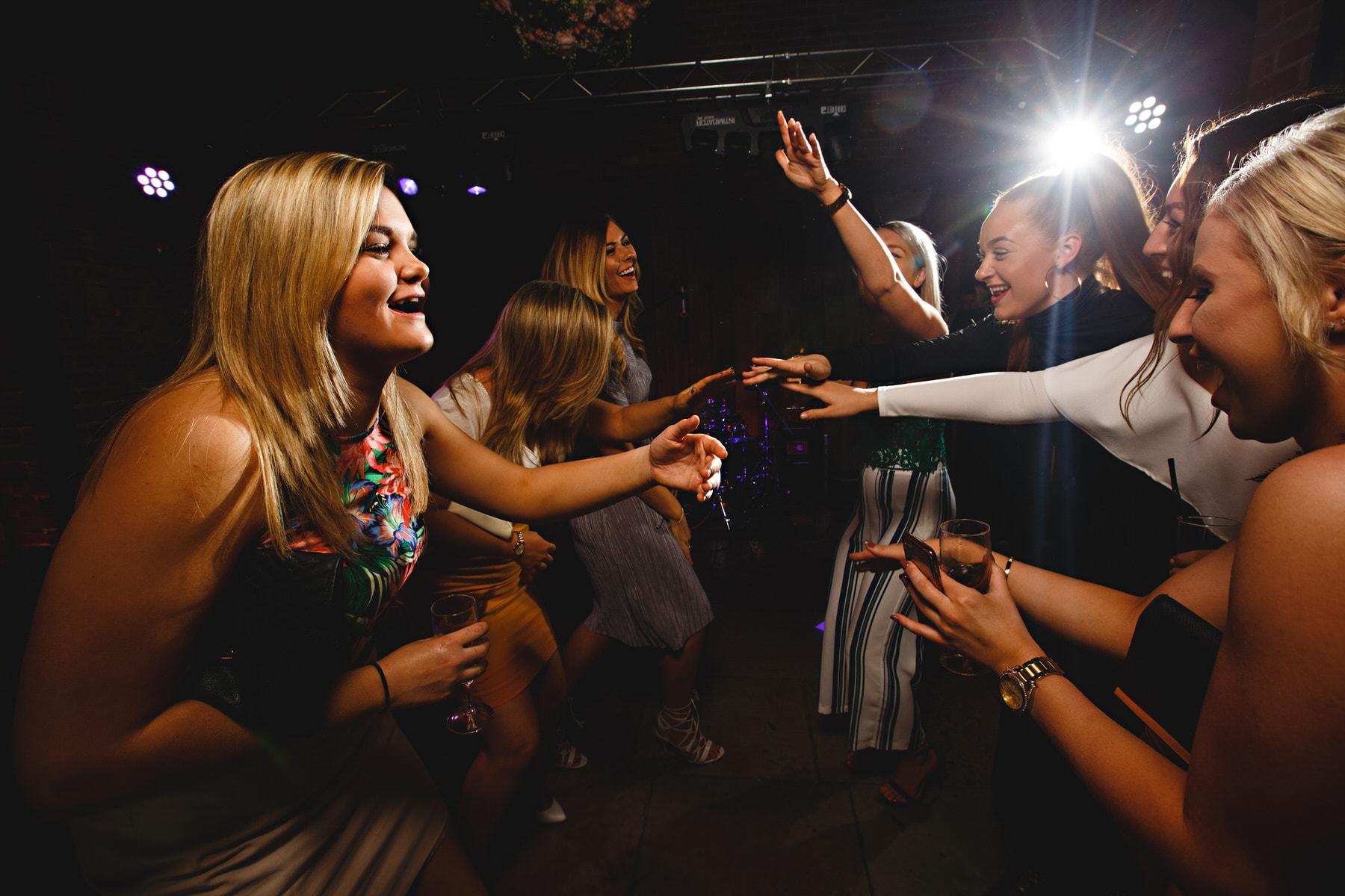 wedding guests dancing at Shustoke Barns in Warwickshire
