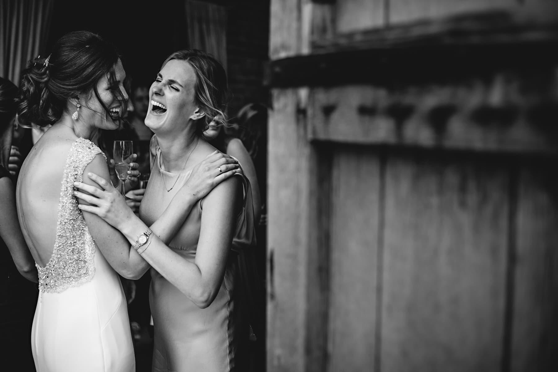 friend hugging at a wedding