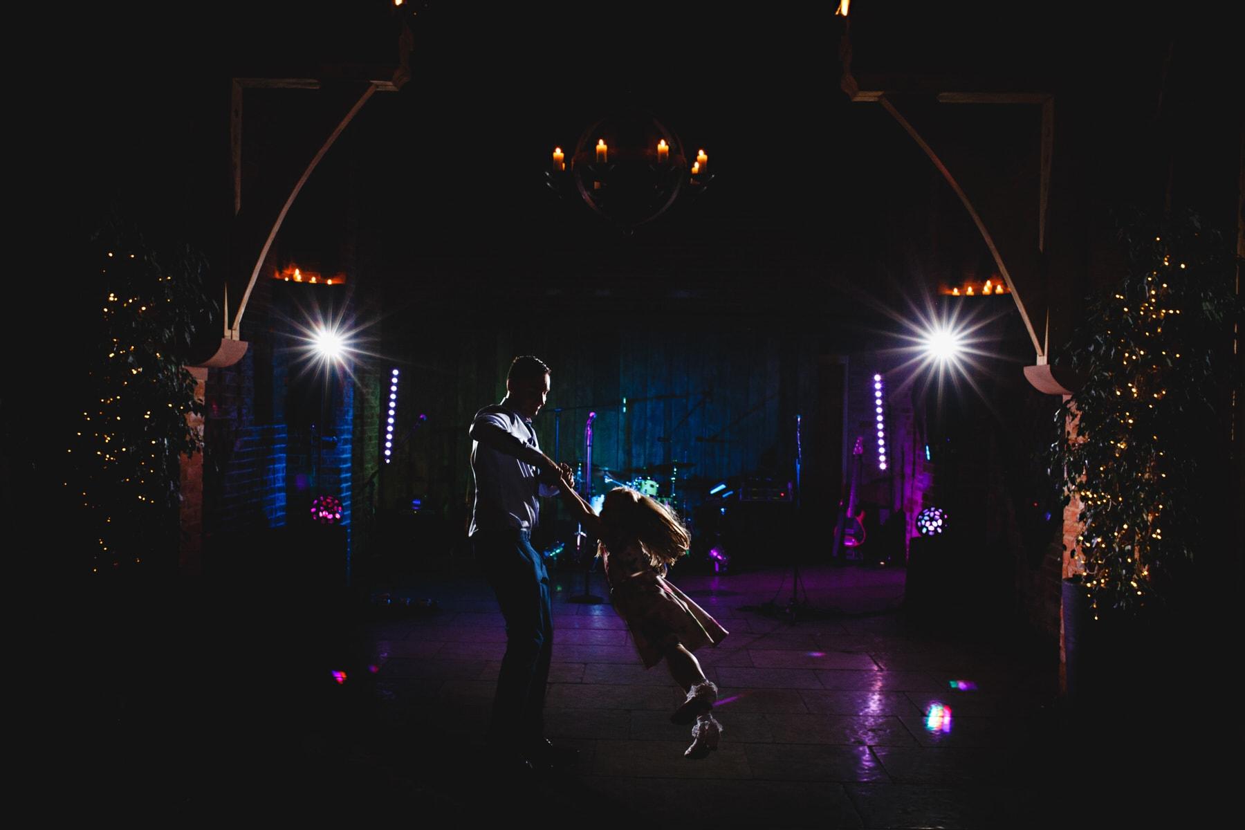 children dancing in blue lights at Shustoke Barns in Warwickshire