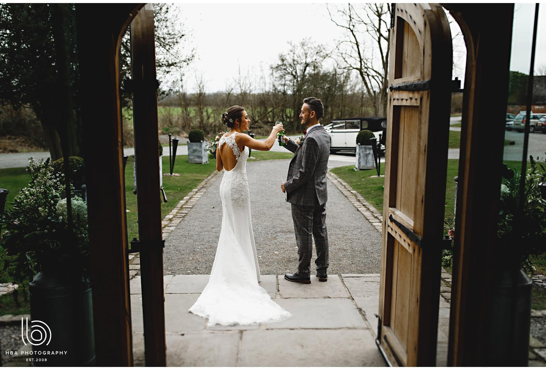 the bride & groom outside the front door of Shustoke