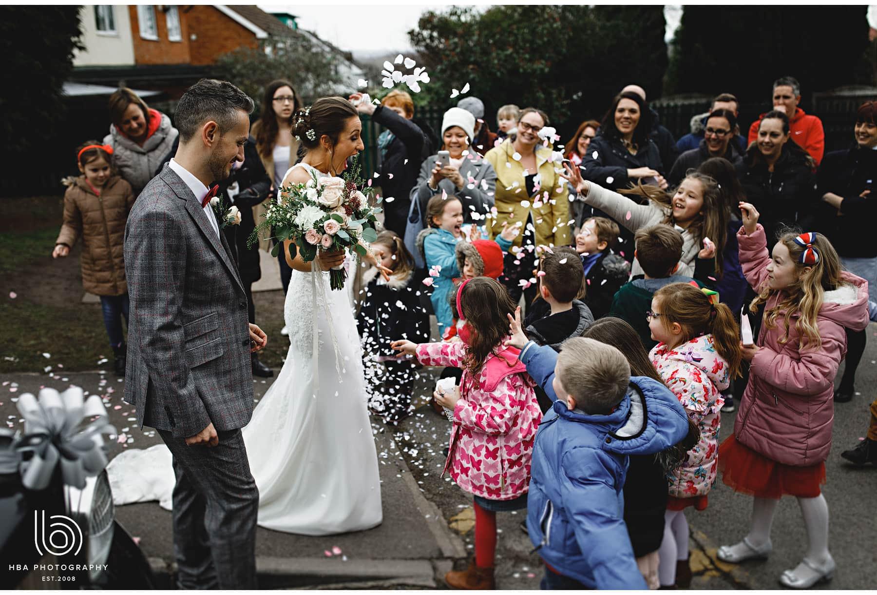 the bride & groom with the brides school children
