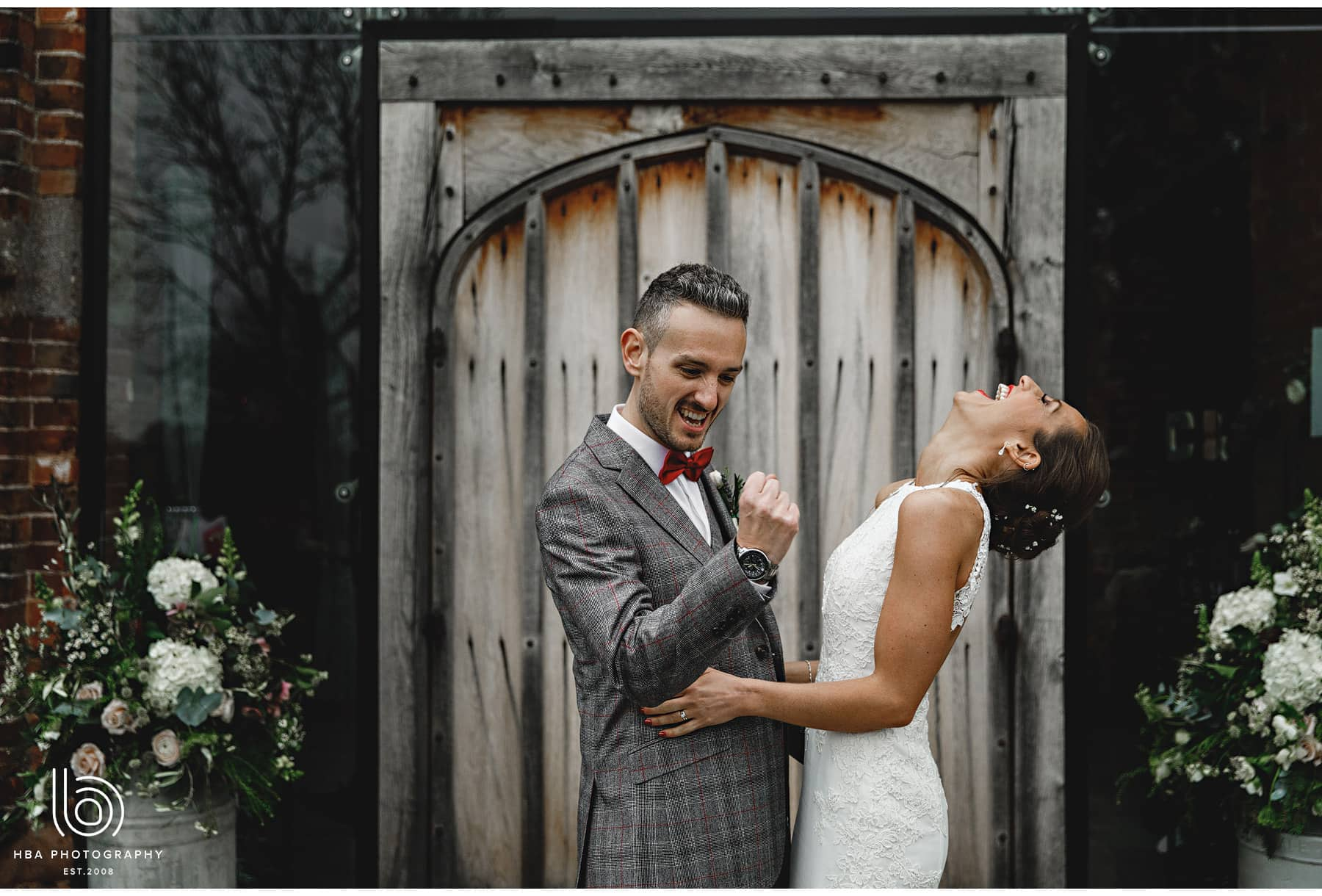the groom cheers and his wife laughs