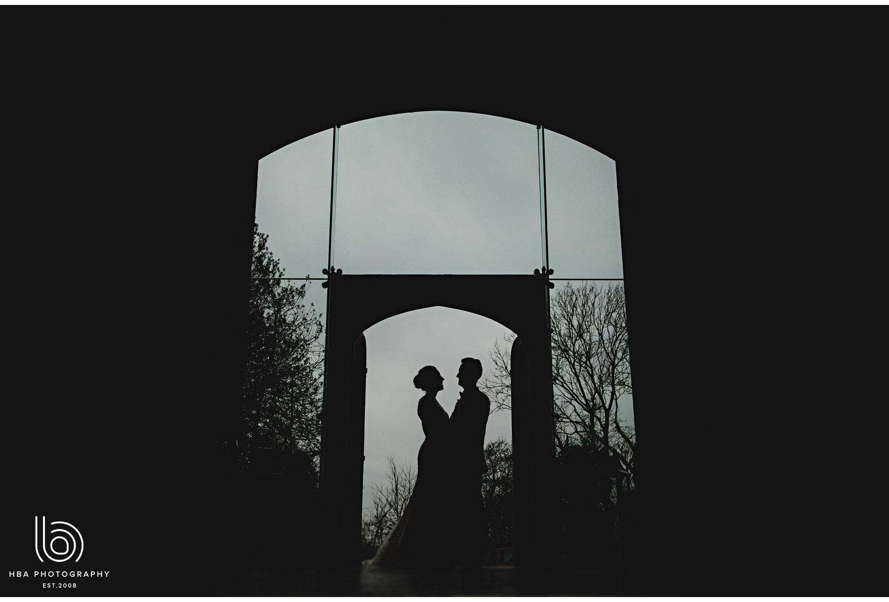 the bride & groom in silhouette