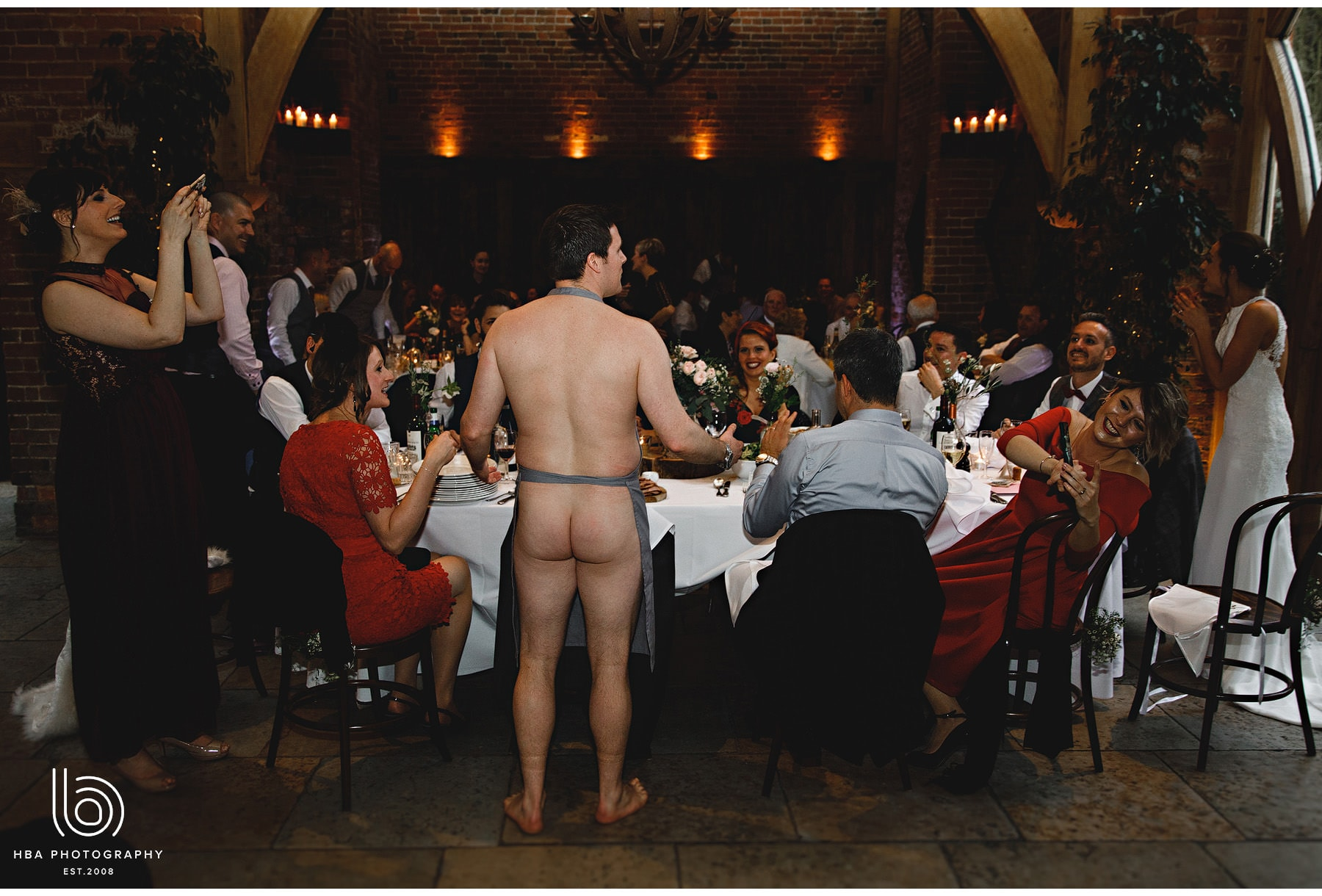 a naked guest serving dinner