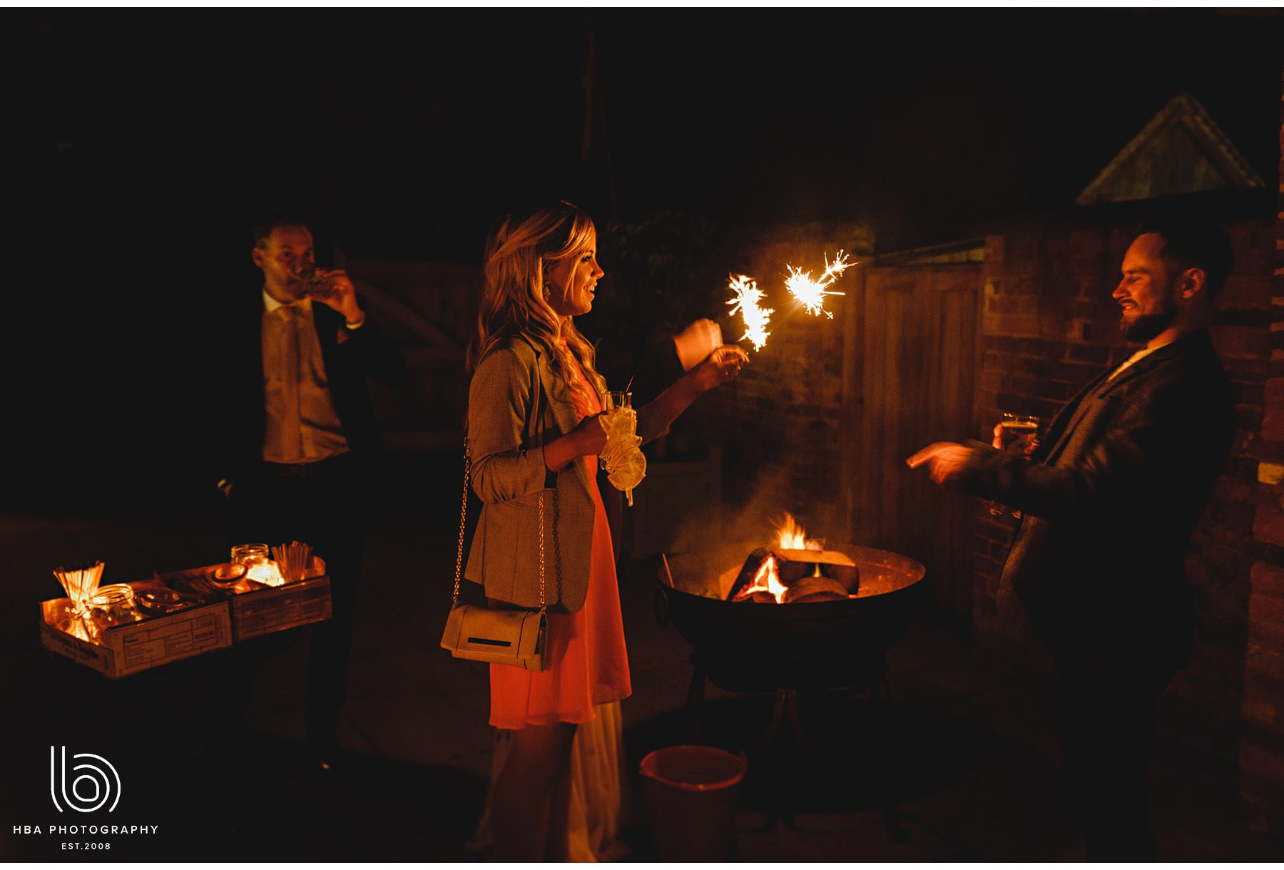 weddng guests by the fire pits