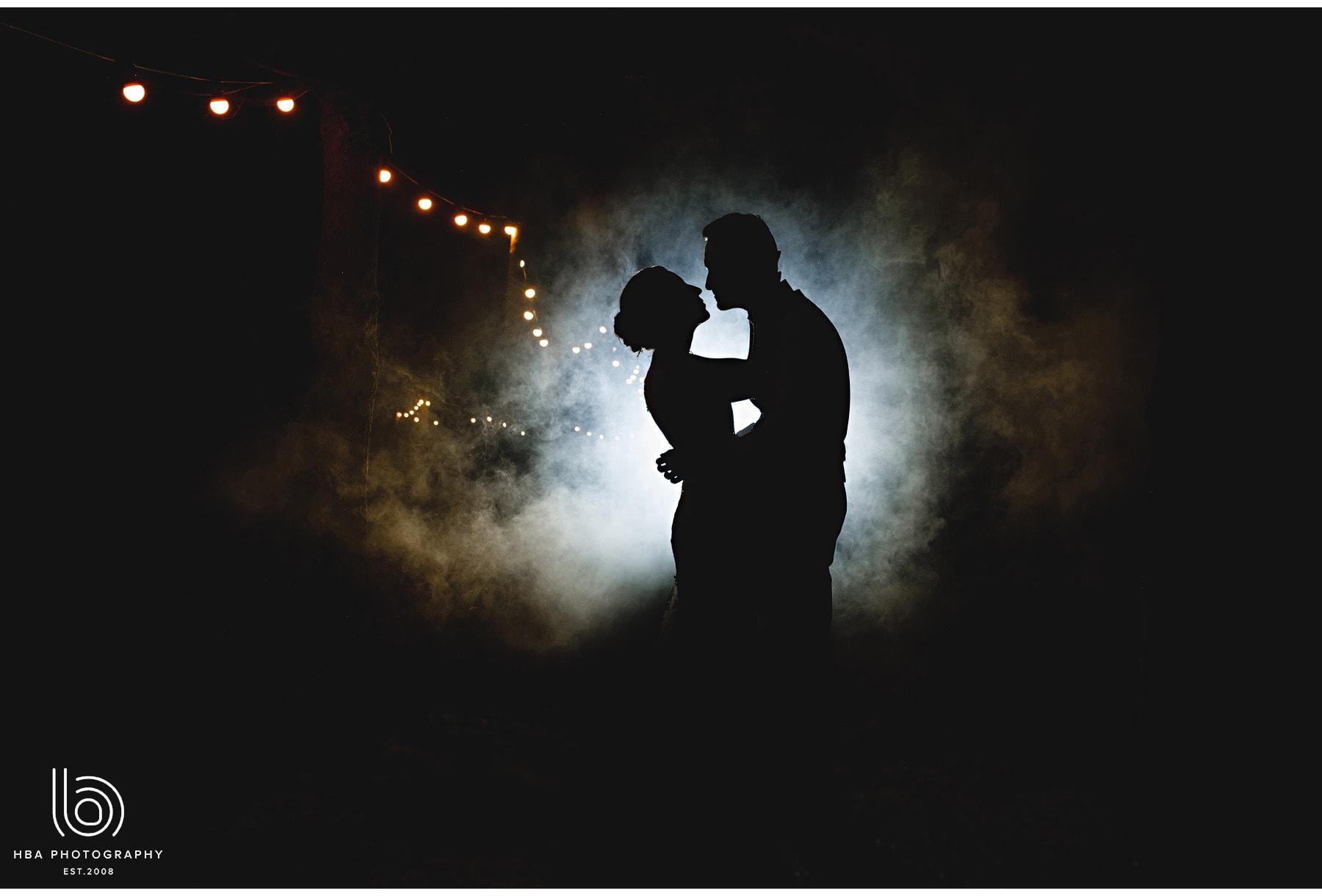 the bride & groom in the msoke at Shustoke