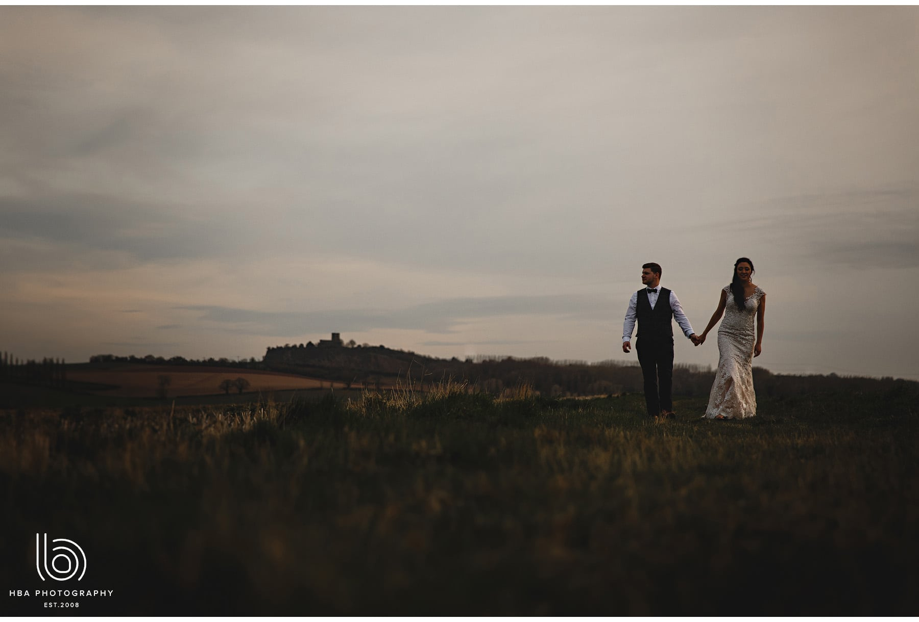 bride and groom walking at dusk