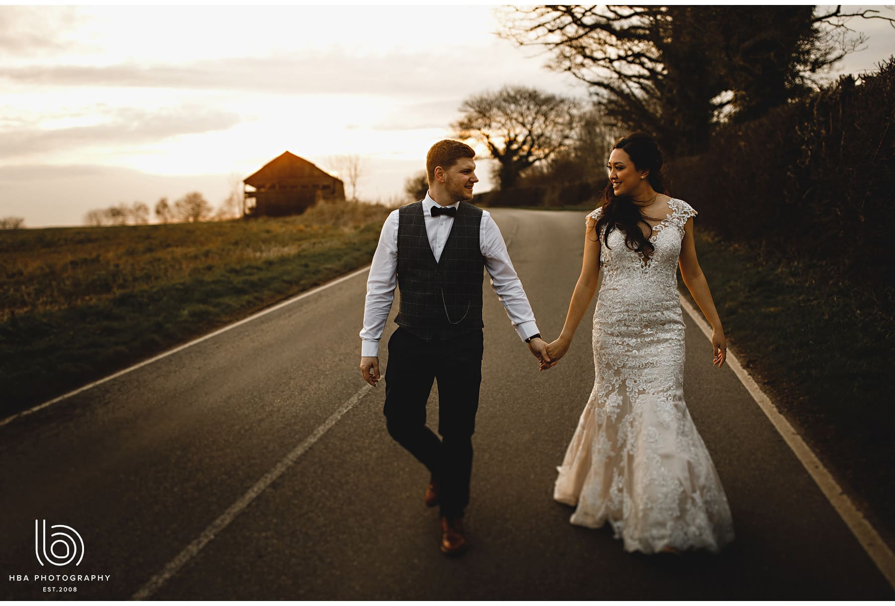 bride and groom walking down the road