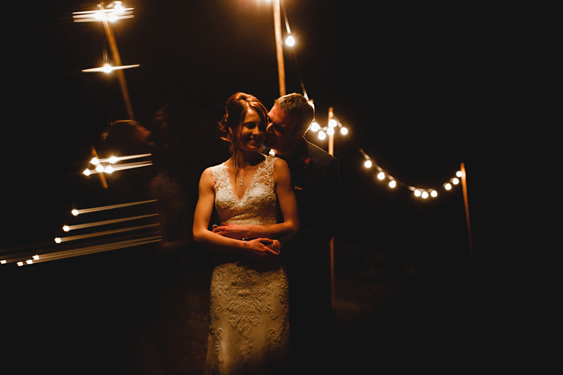 the bride and groom together at The Lingholme Estate under the festoon lights