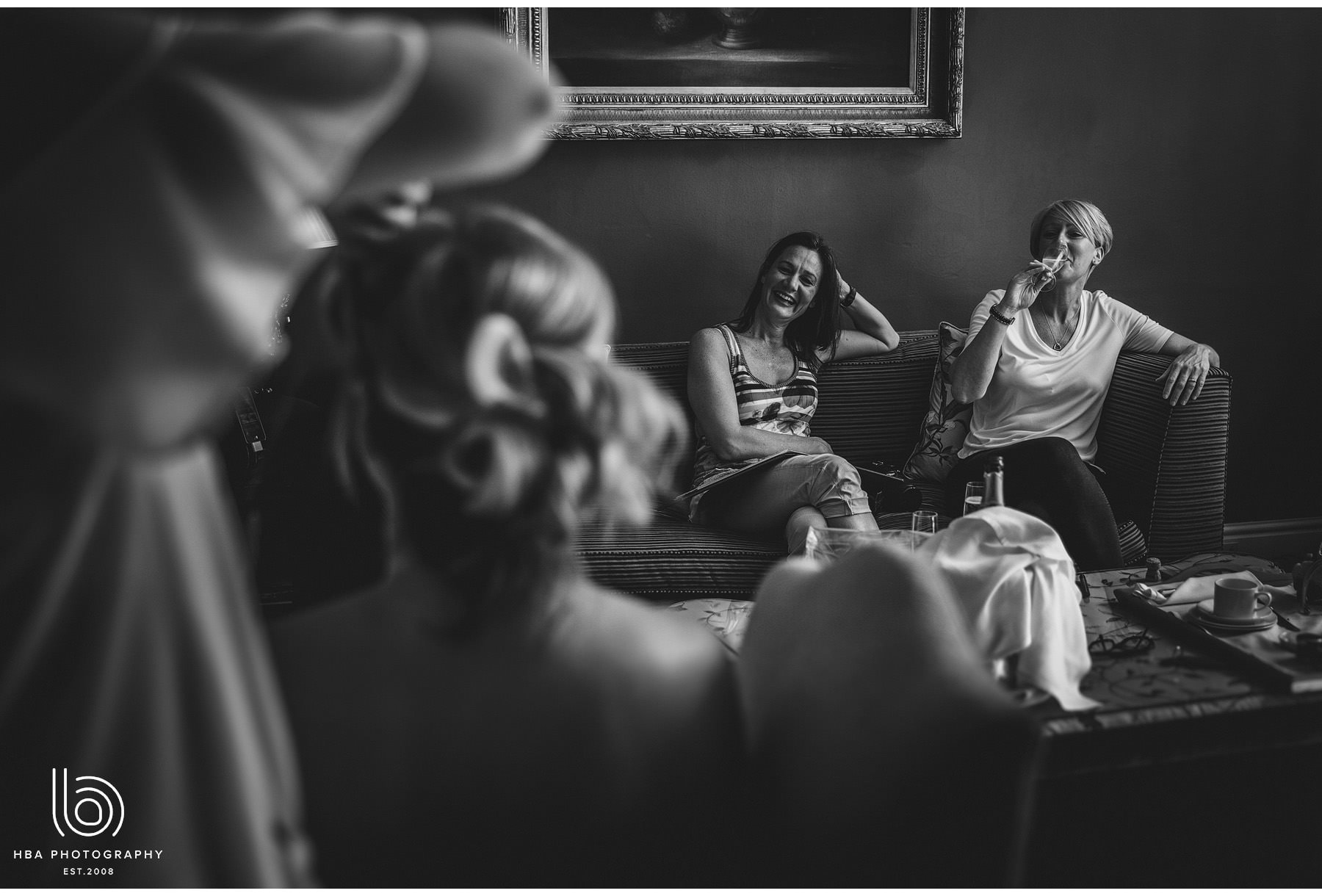 friends and the bride laughing