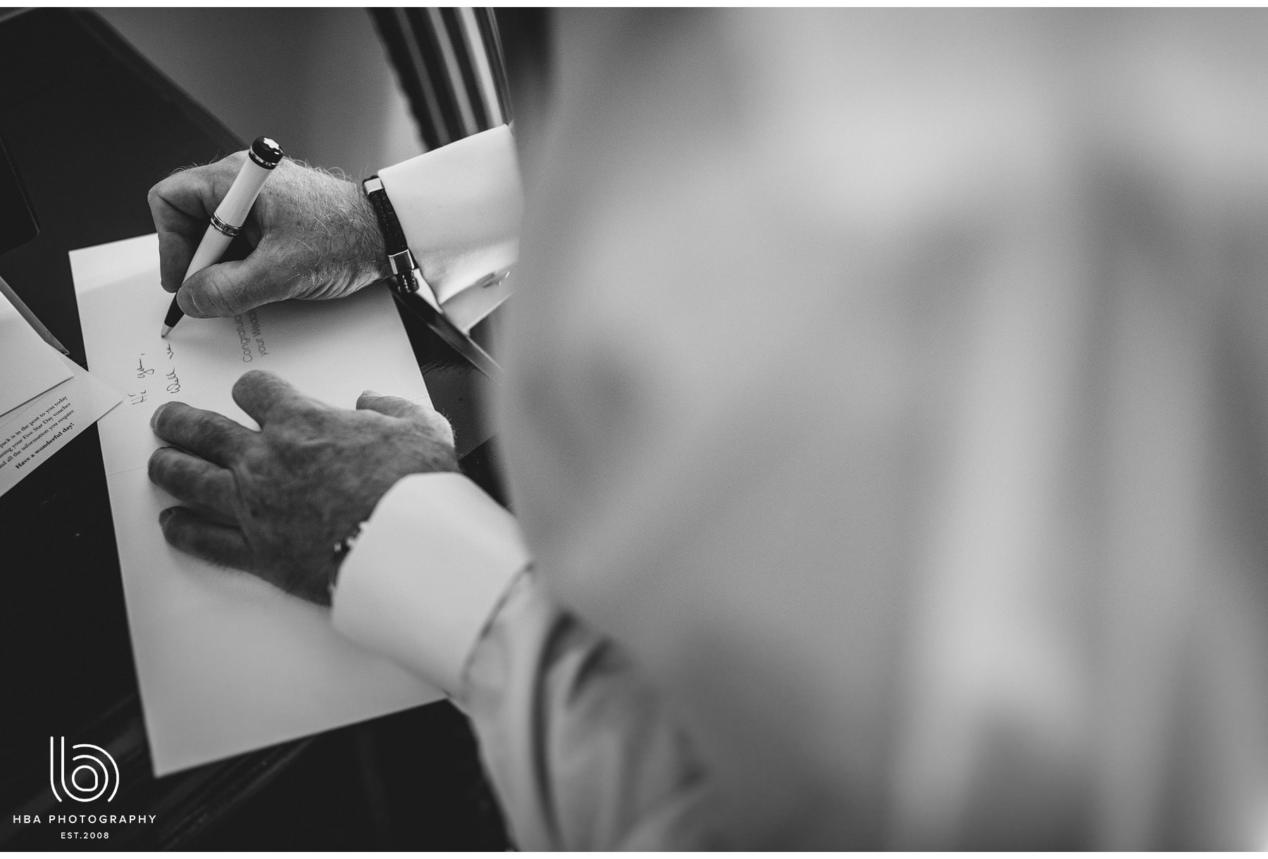 the groom writing a card