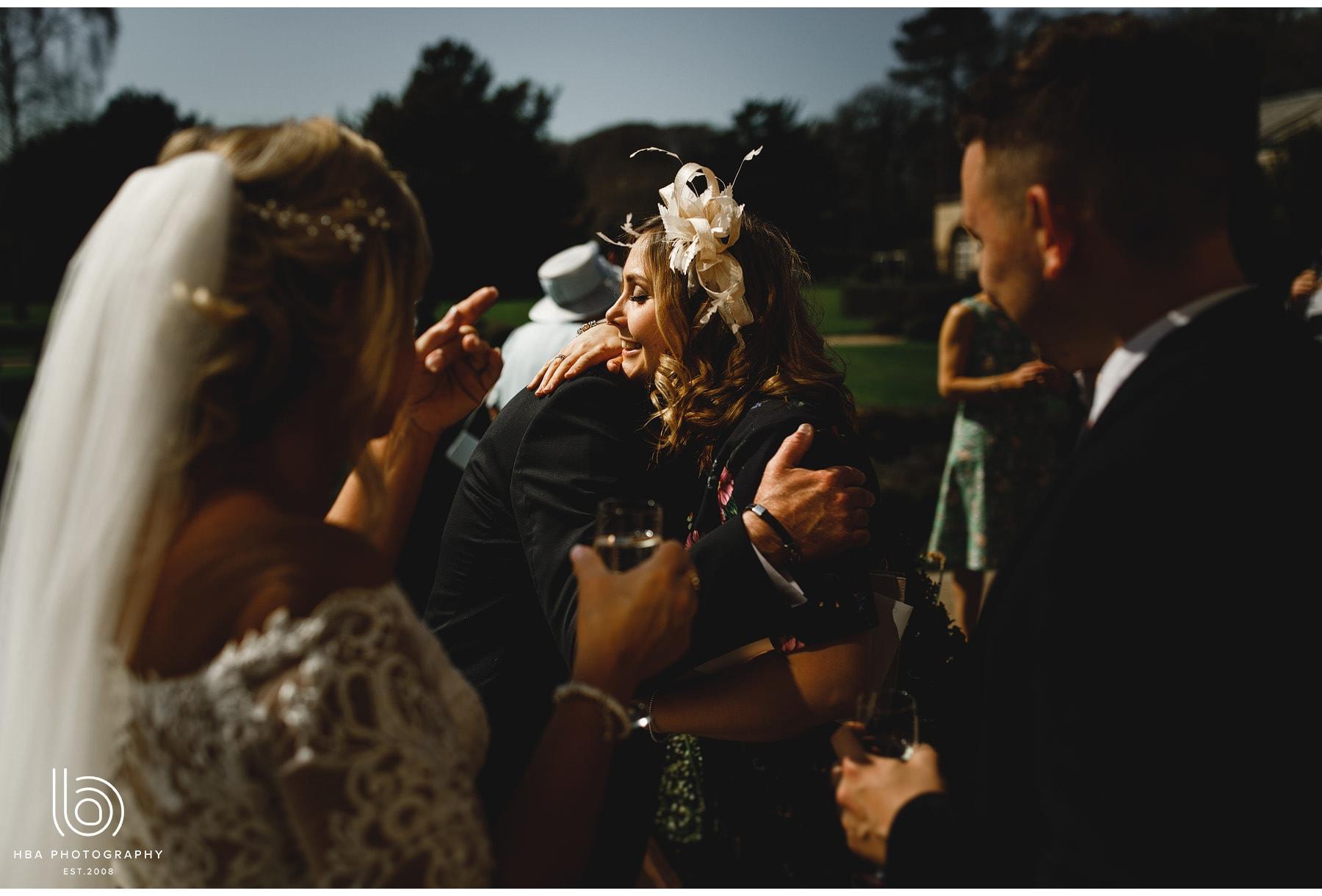 hugging wedding guests